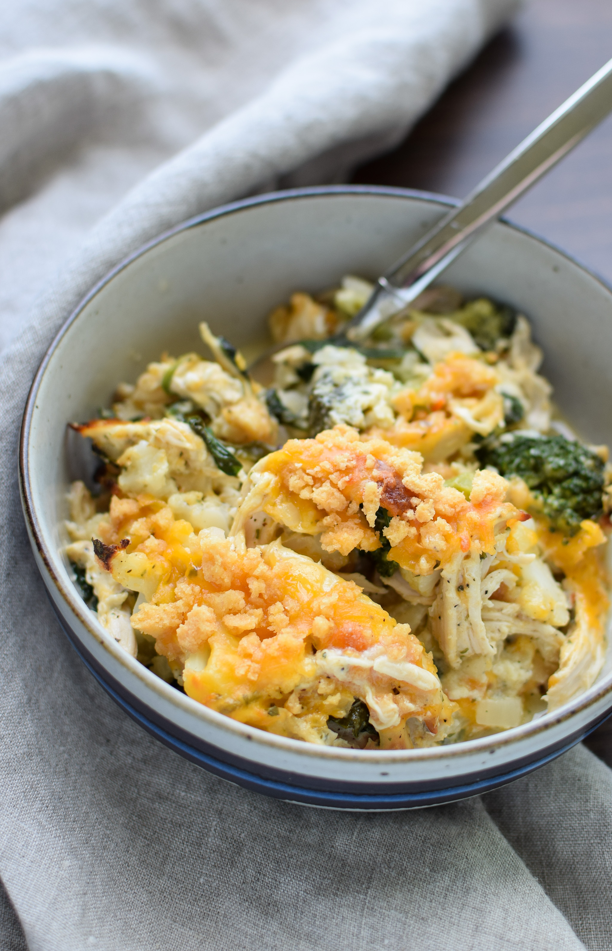 A bowl of Veggie Loaded Rotisserie Chicken Casserole.