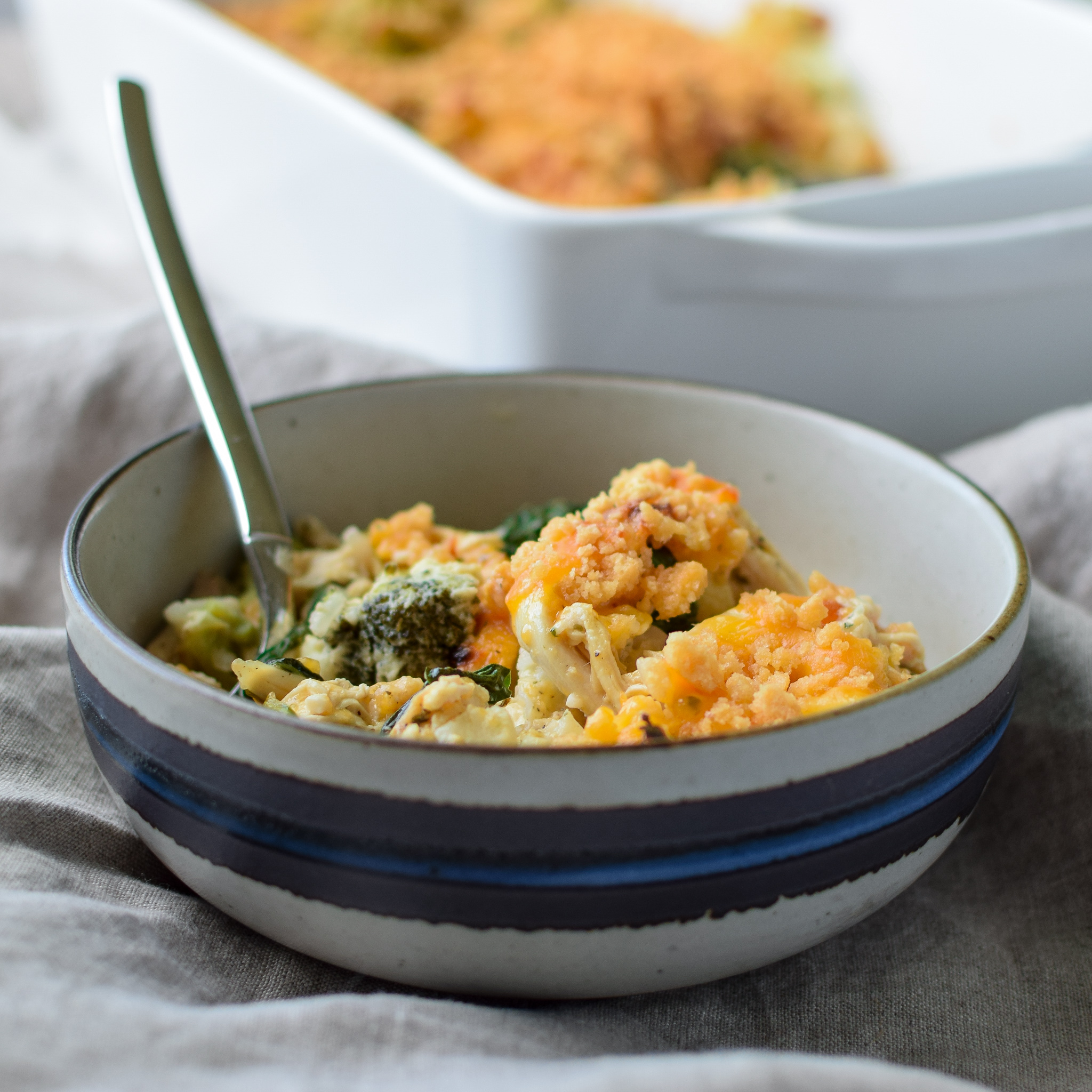 A fresh dished up bowl of Veggie Loaded Rotisserie Chicken Casserole.