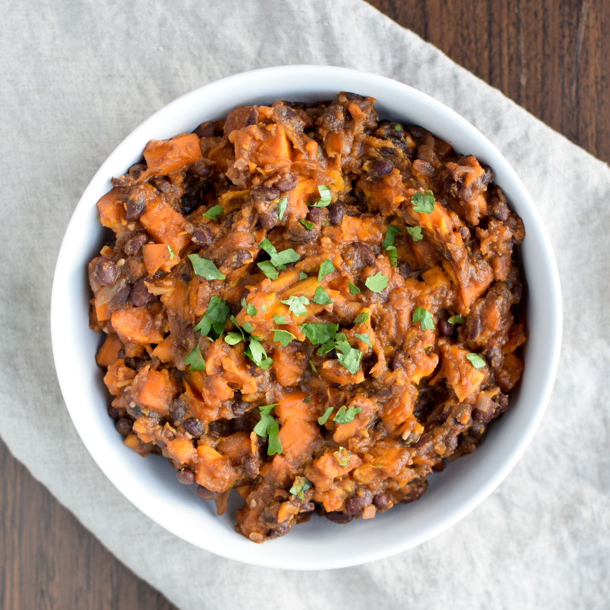 BBQ Black Bean Slow Cooker Sweet Potatoes - Black beans, sweet potatoes, and spicy BBQ sauce. A match made in side dish heaven! - ProjectMealPlan.com
