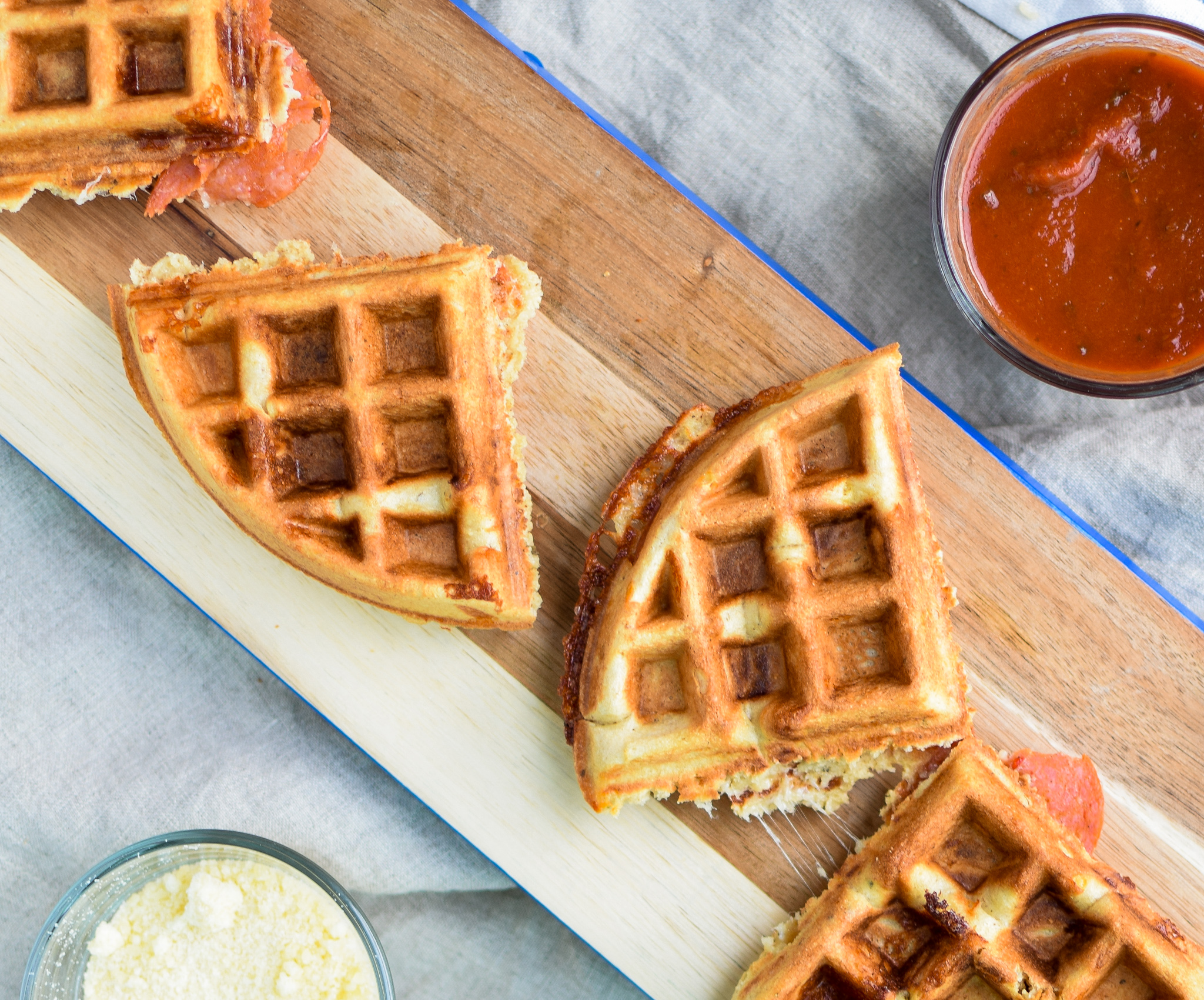 Protein Packed Pepperoni Pizza Waffles - Pizza + Waffles made super easy at home! Stuffed with mozzarella and pepperoni, plus packed with protein! - ProjectMealPlan.com