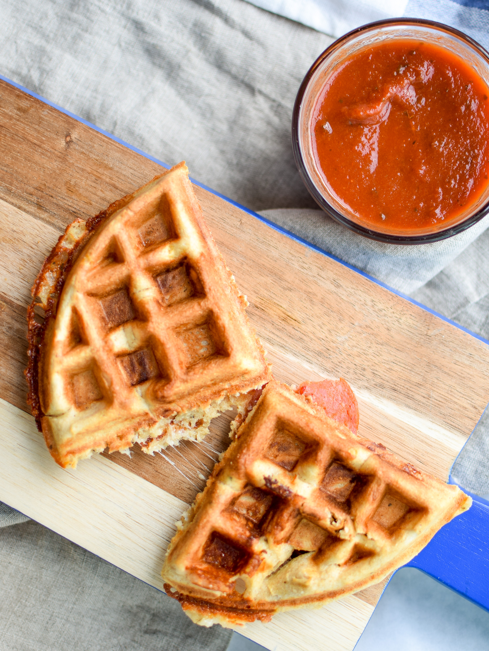 Pizza + Waffles made super easy at home! Stuffed with mozzarella and pepperoni, plus packed with protein!