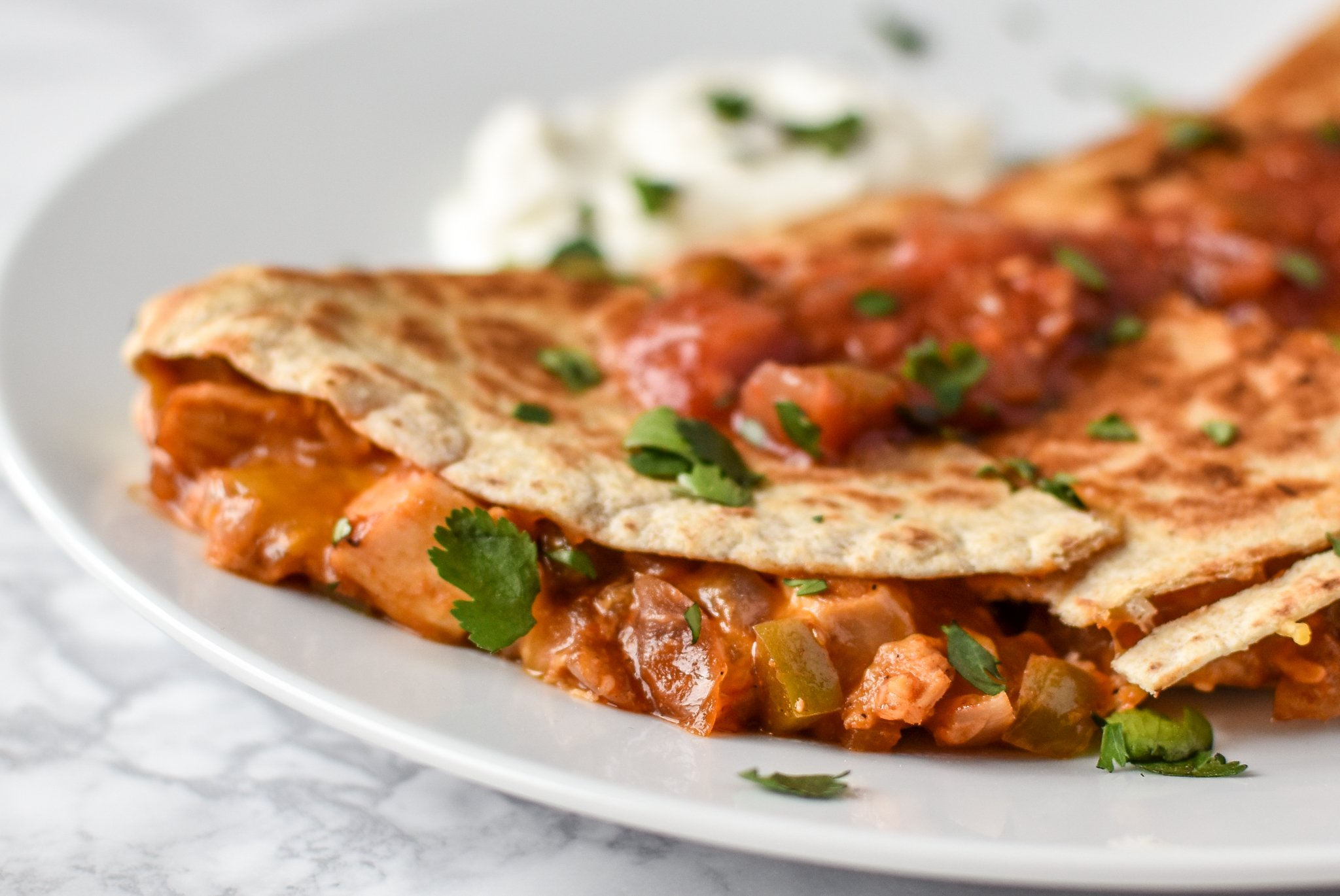 Quick BBQ Chicken Quesadillas (Make-Ahead Filling Recipe) - Delicious BBQ chicken quesadillas made in 10 minutes with pre-made filling! - ProjectMealPlan.com