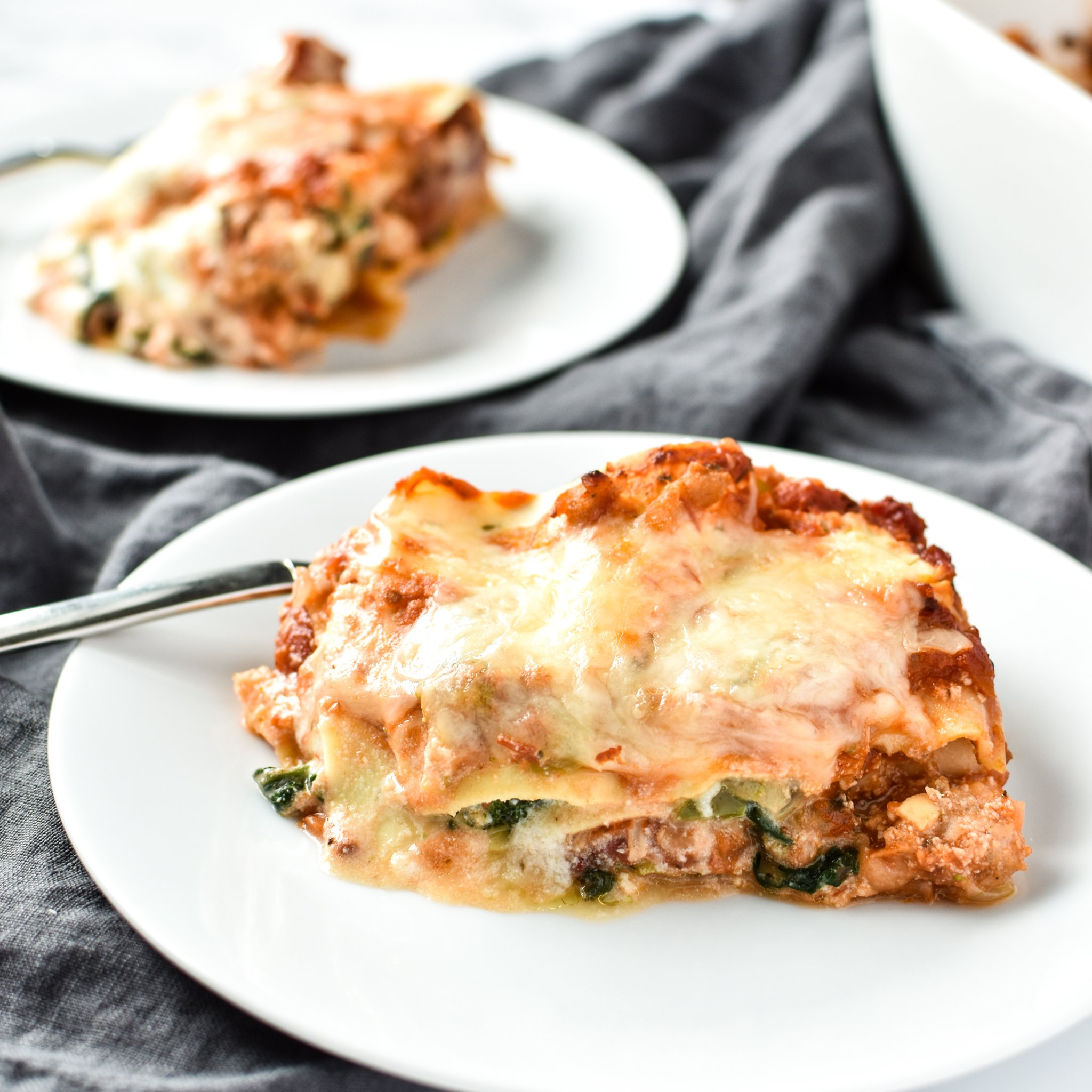 Leftover Vegetable Italian Chicken Lasagna Recipe - Use up leftover veggies in my favorite deliciously layered ground chicken lasagna! - ProjectMealPlan.com