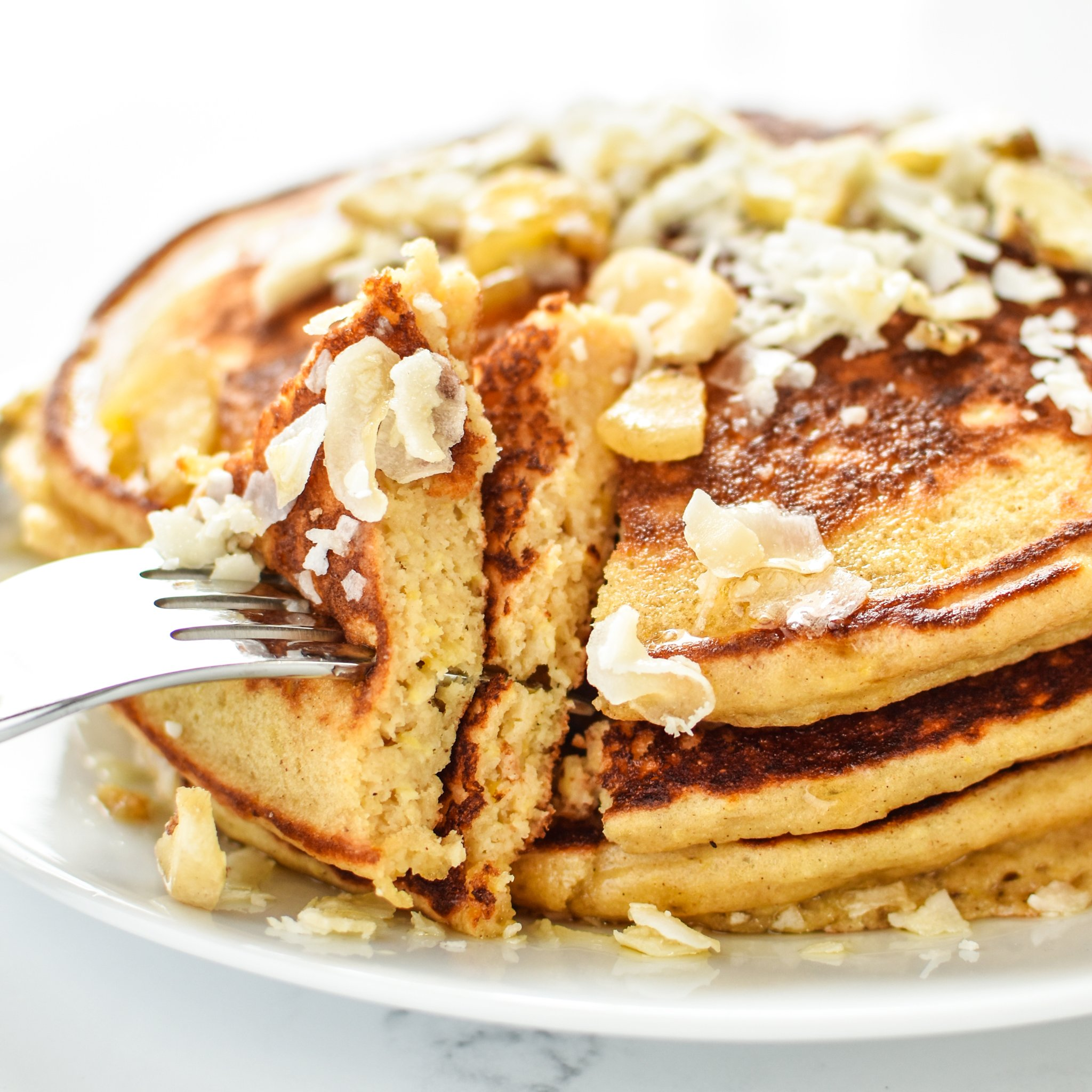 Tropical Pineapple Protein Pancakes Recipe - A perfect blend of pineapple helps keep these delicious protein pancakes moist and perfect for on-the-go! - ProjectMealPlan.com