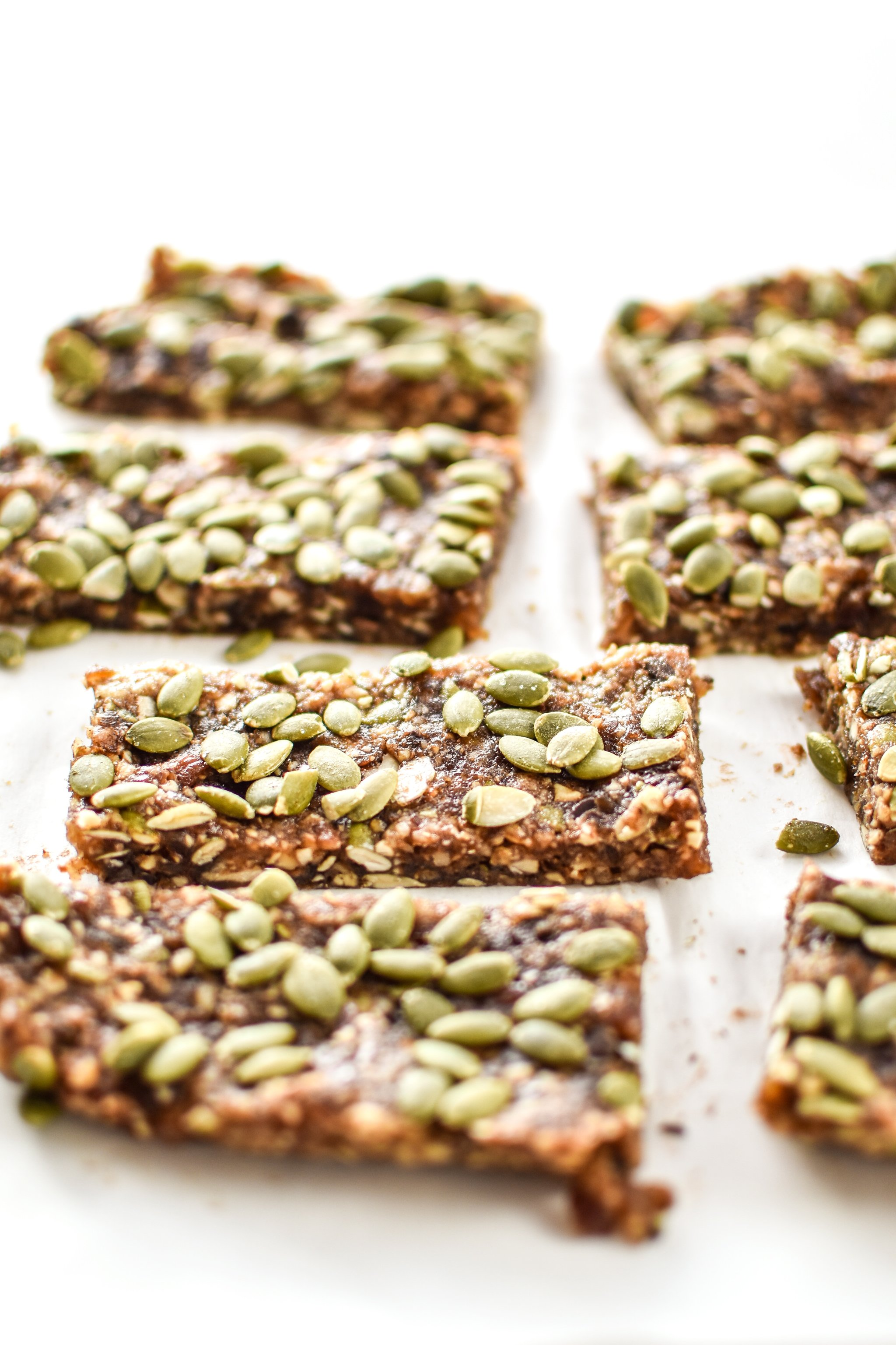 No-Bake Pumpkin Spice Date Nut Bars cut and ready to eat