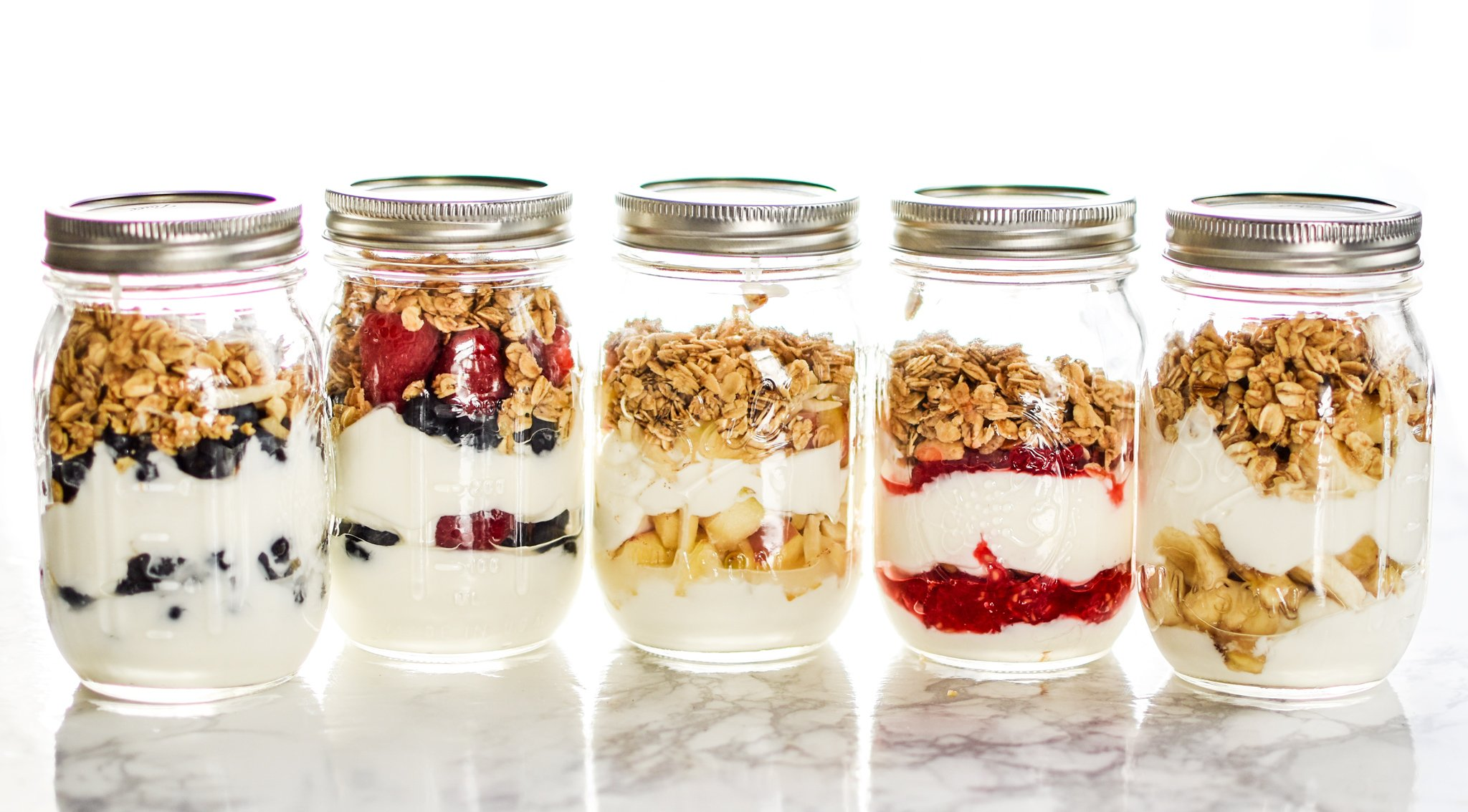 5 Make-Ahead Fruit & Greek Yogurt Parfait Ideas to Try for Breakfast - Greek yogurt with just a hint of sweetness, layered with fruits and topped with granola, 5 WAYS!! Prep ahead and grab it on your way out the door tomorrow! - ProjectMealPlan.com