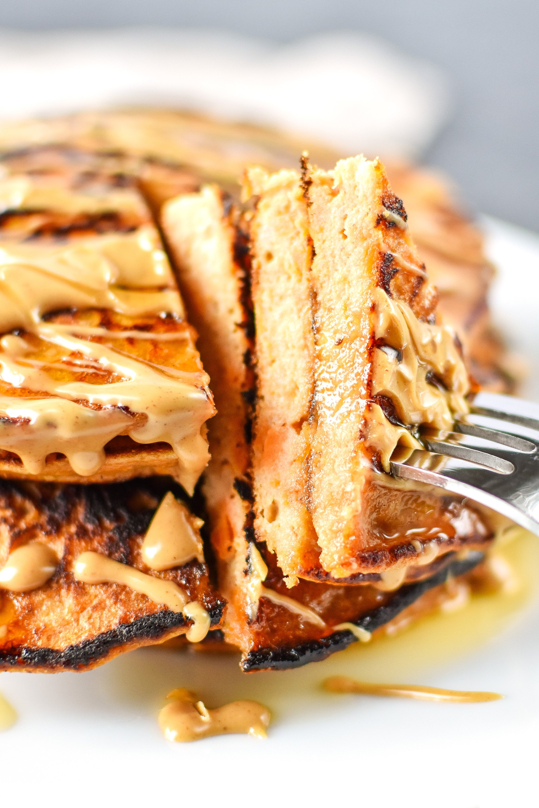 5-Ingredient Sweet Potato Banana Pancakes - Banana, sweet potato, nut butter, eggs and cinnamon are all you need to make these simple pancakes happen! - ProjectMealPlan.com