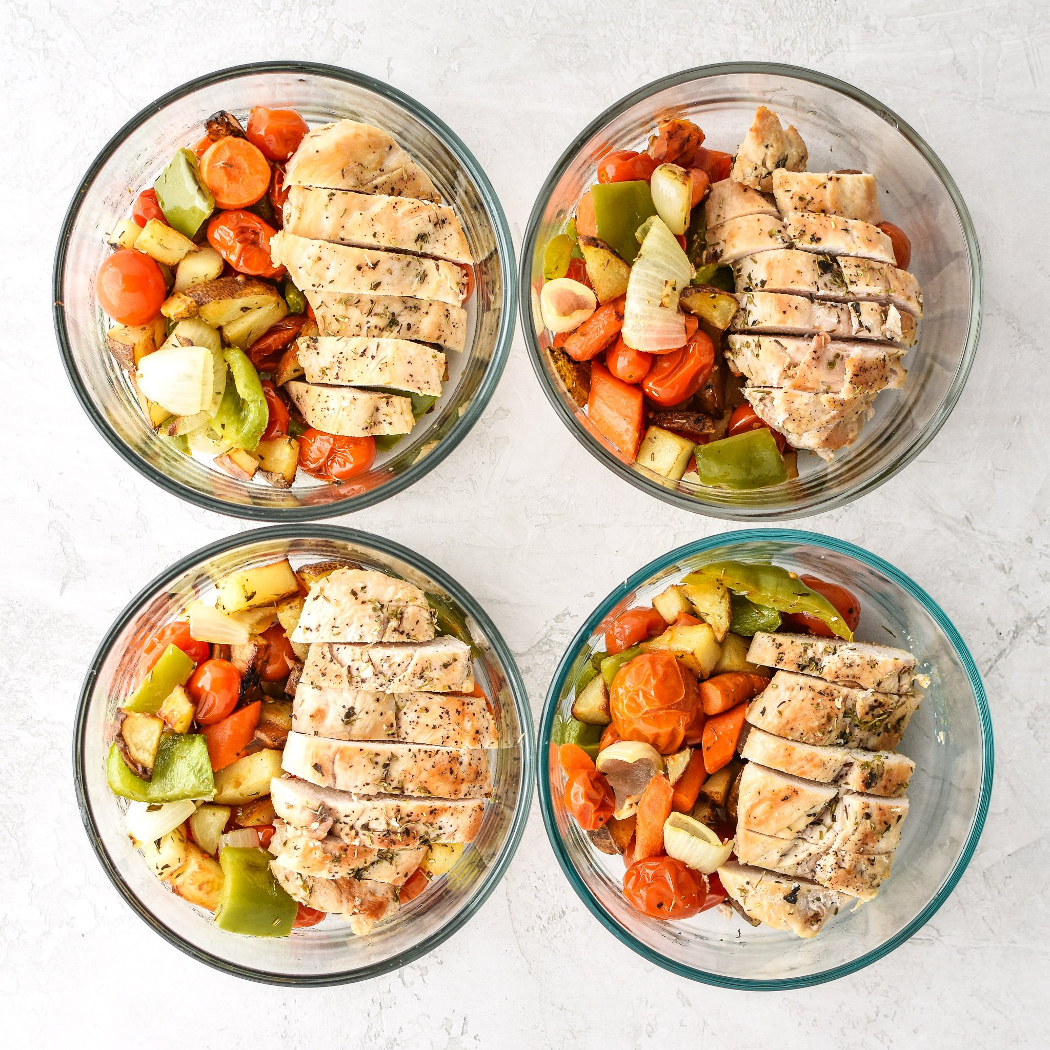 Meal Prep Italian Seasoned Chicken with Roasted Imperfect Vegetables - Simple, healthy, easy italian seasoned chicken with very Imperfect oven roasted potatoes, peppers, cherry tomatoes, carrots, and onions! - ProjectMealPlan.com
