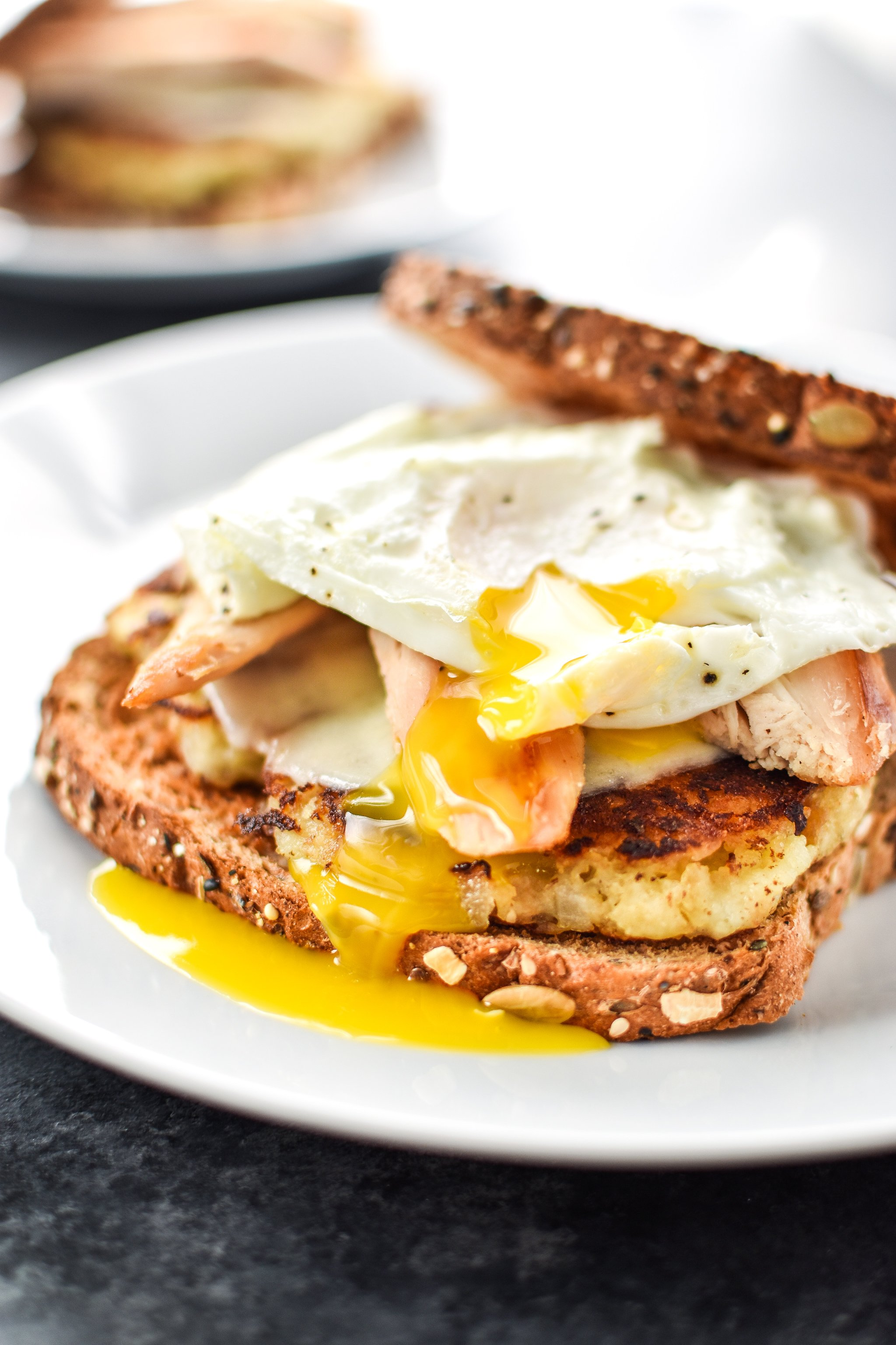 Ultimate Leftover Turkey Breakfast Sandwich - The best use of your holiday leftovers! Stuffing, mashed potatoes, turkey, topped with a soft yolk fried egg! ProjectMealPlan.com