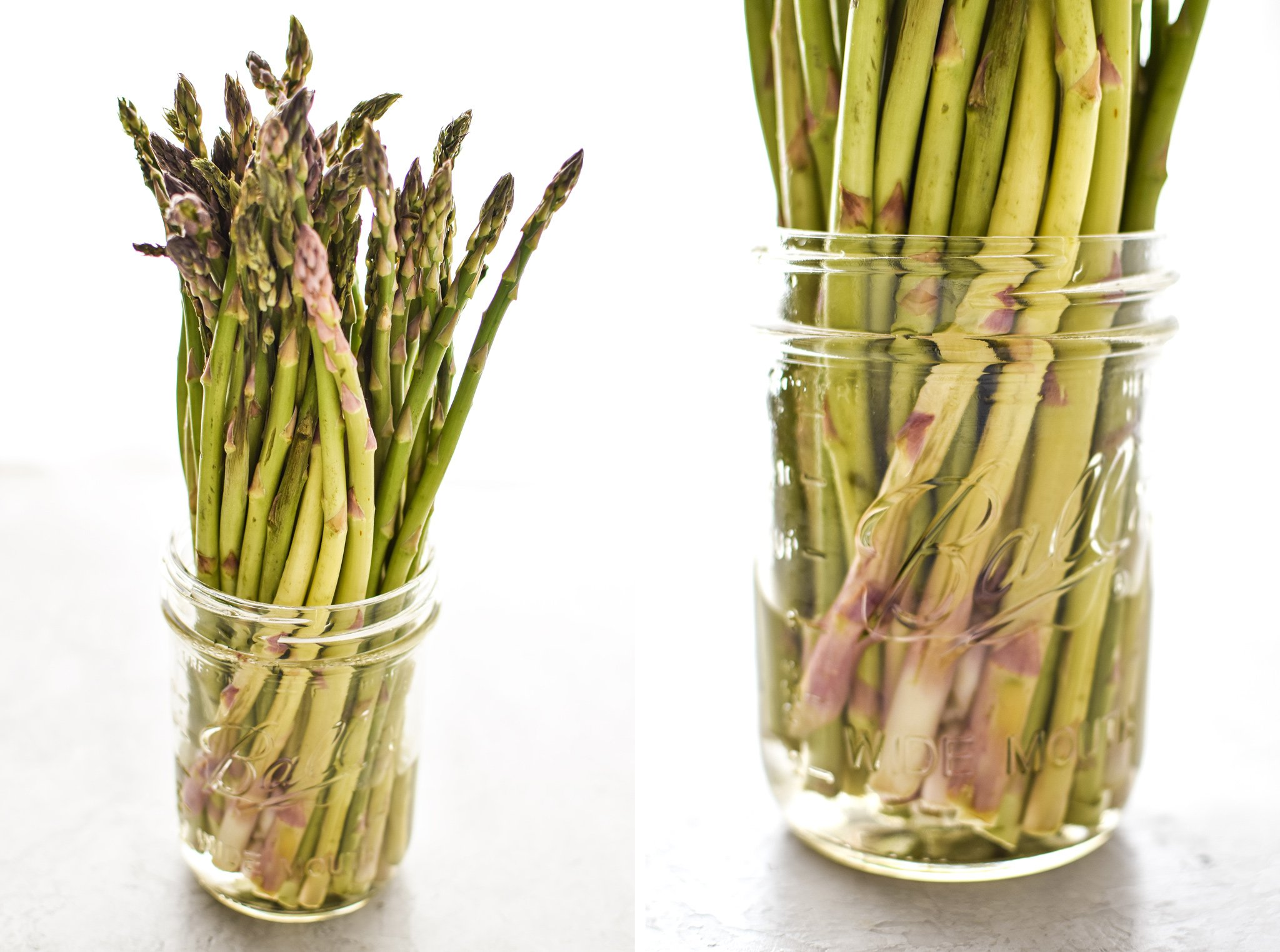 Asparagus spears in some water in a mason jar to keep them fresh.