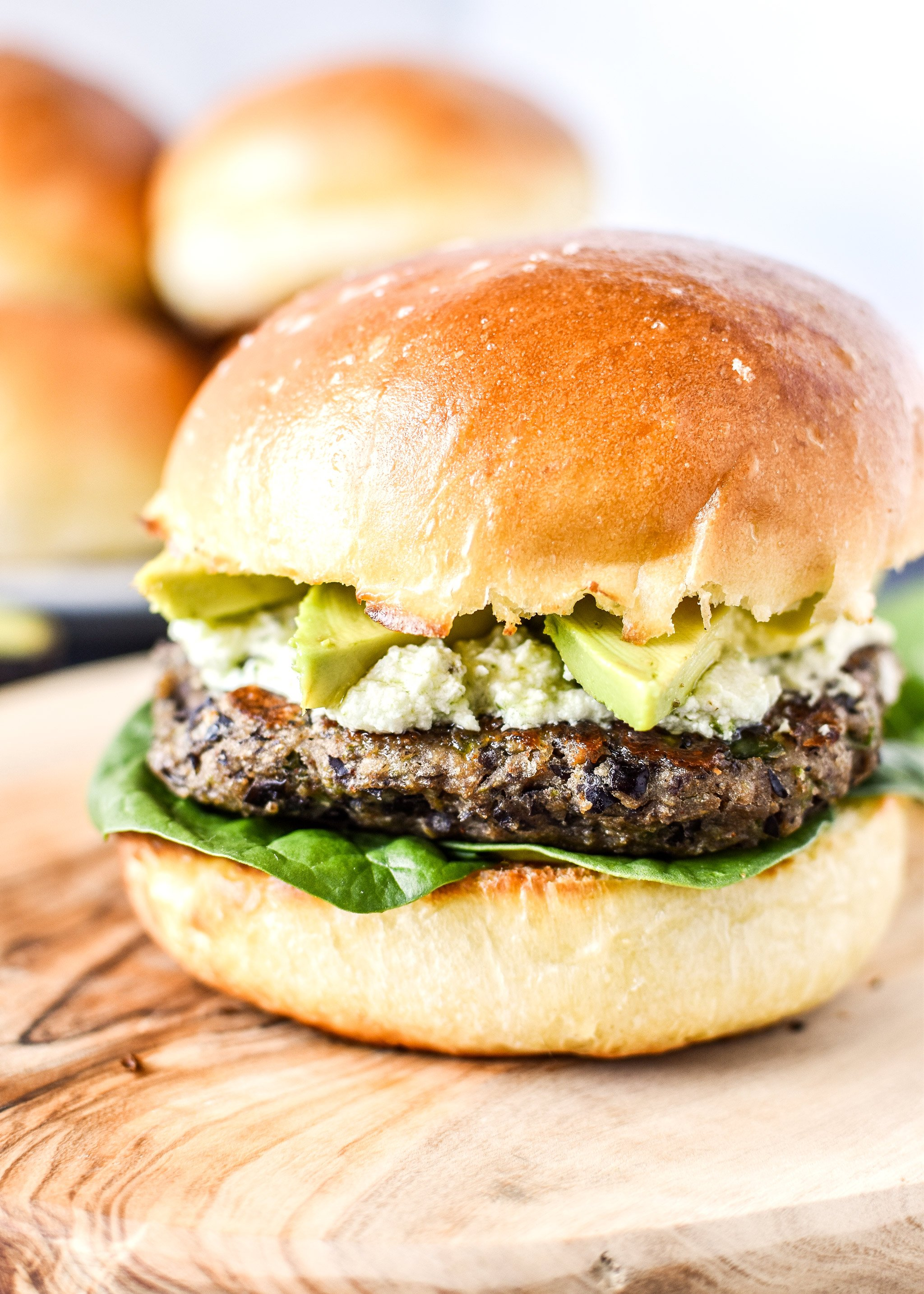 Freezer friendly black bean burger with pesto goat cheese and avocado