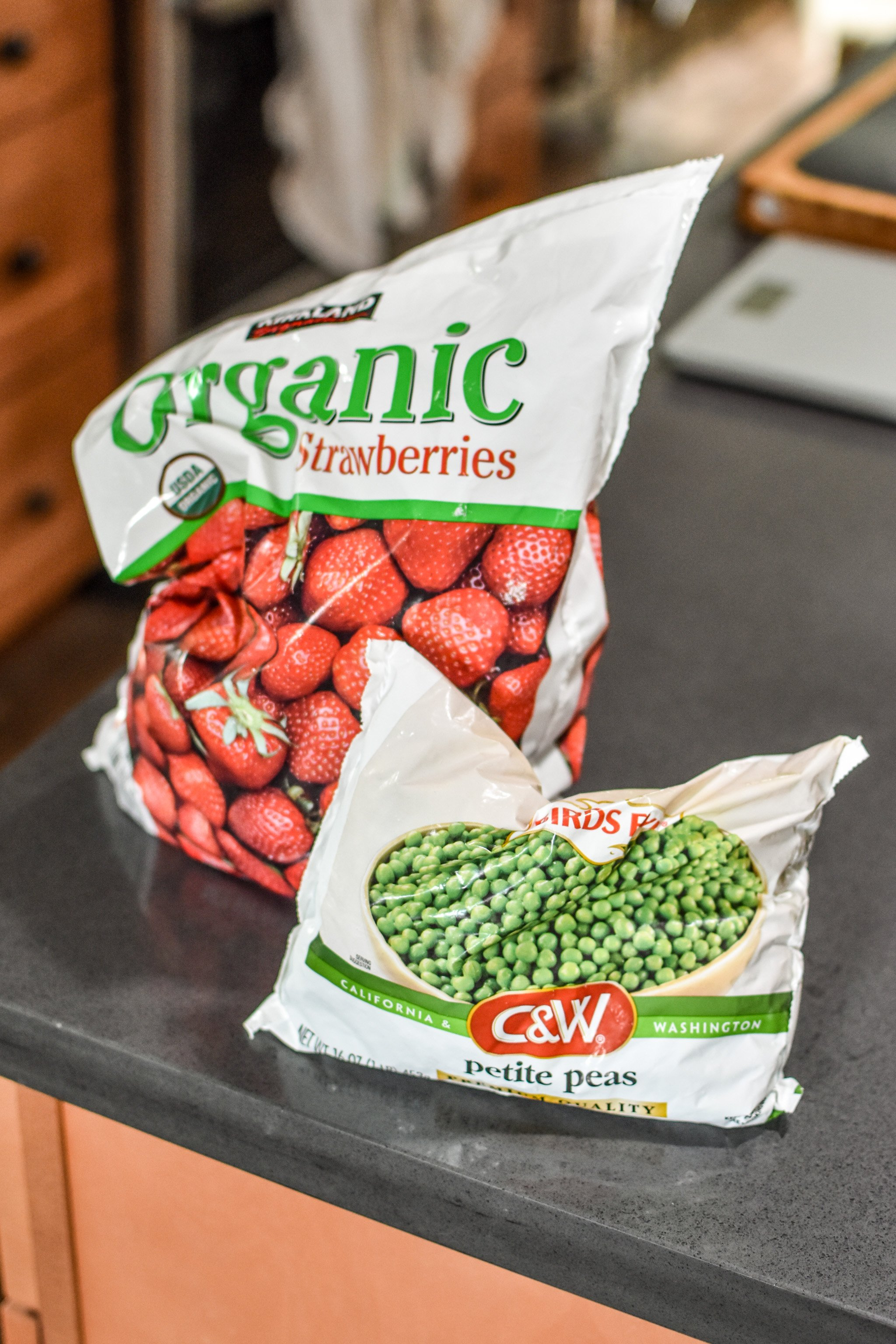 frozen produce like strawberries and peas are good ideas for 10 staple meal prep foods always found in my kitchen.