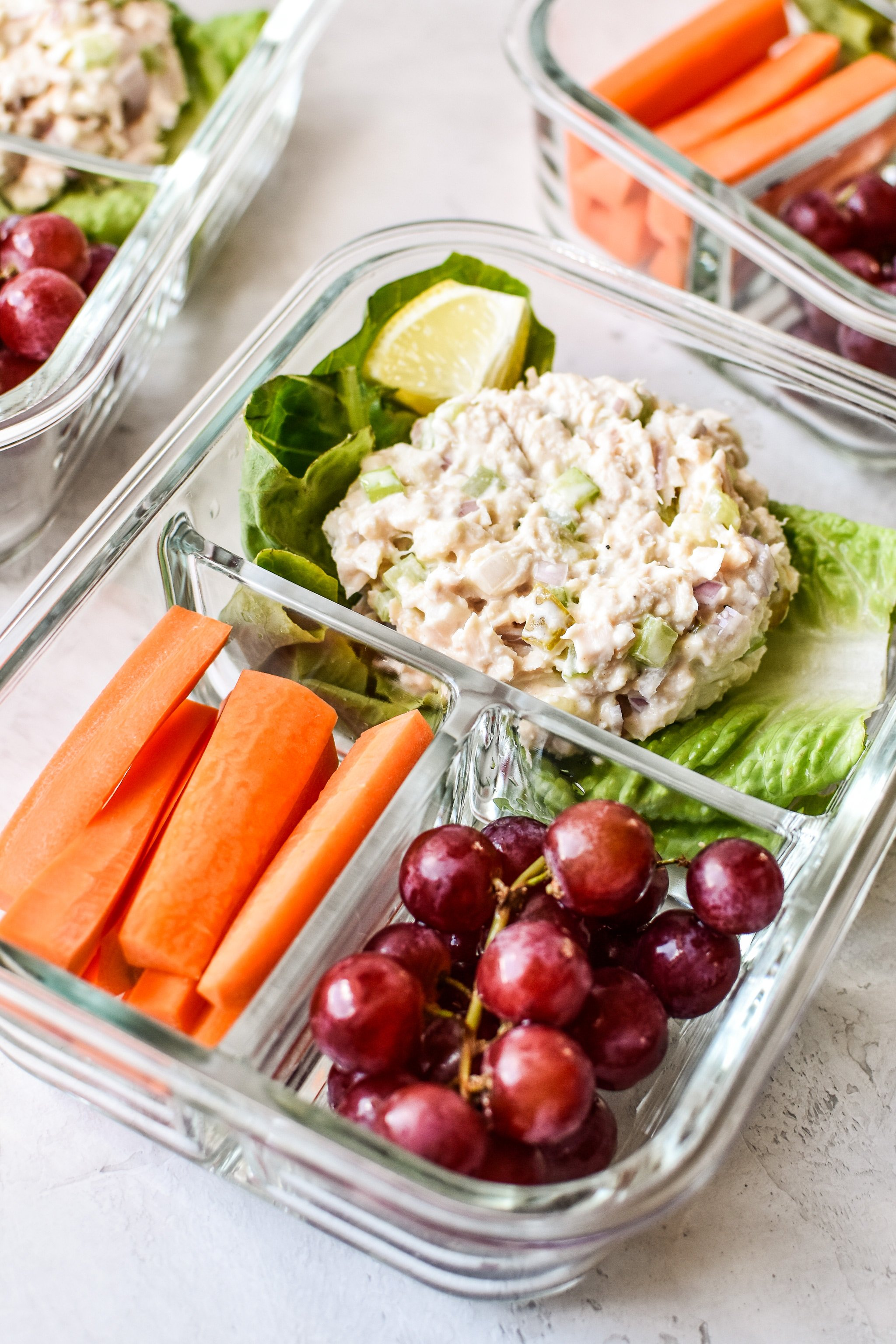 Low carb tuna salad meal prep lunch with carrots and grapes.