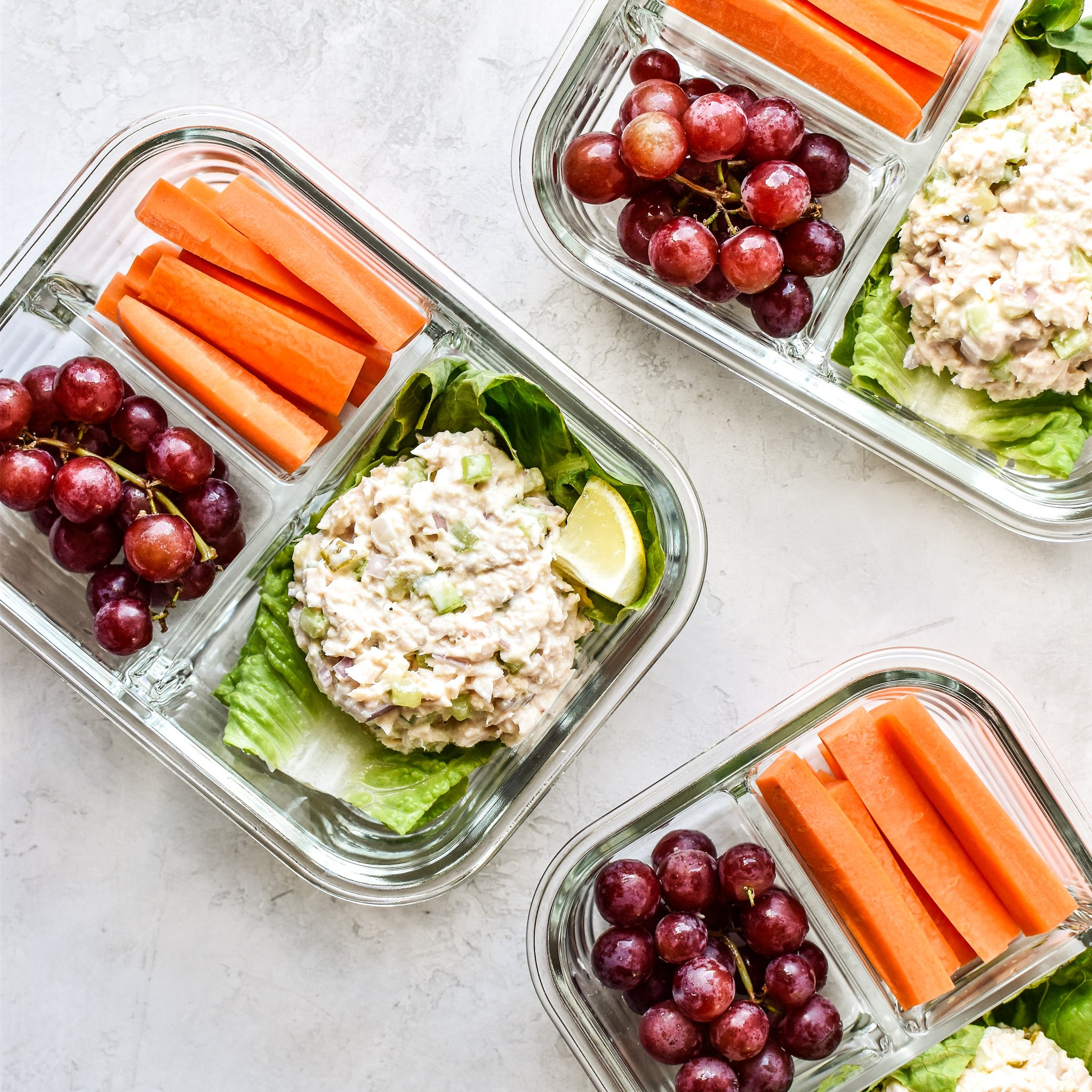 Low carb tuna salad lettuce wraps meal prep lunches with grapes and carrots.