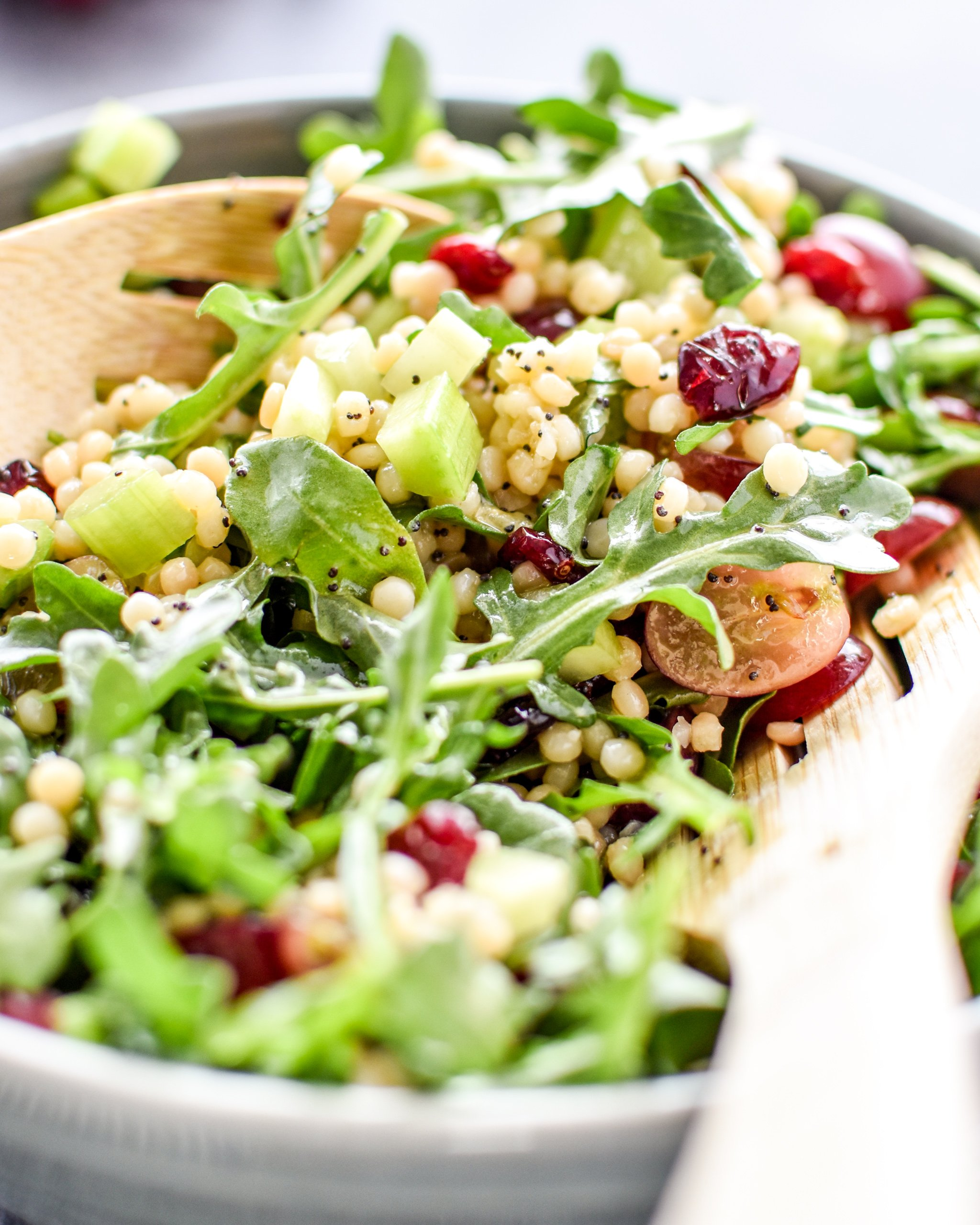 Make ahead lemon poppyseed couscous arugula salad with dressing poured on top.