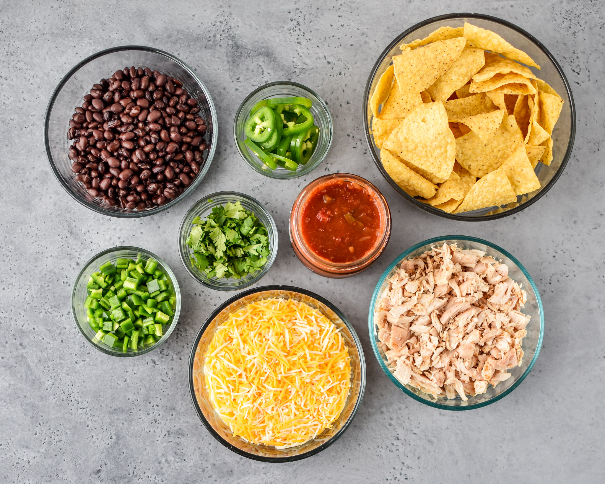 All the ingredients prepped ahead of time for these prep ahead rotisserie chicken nachos