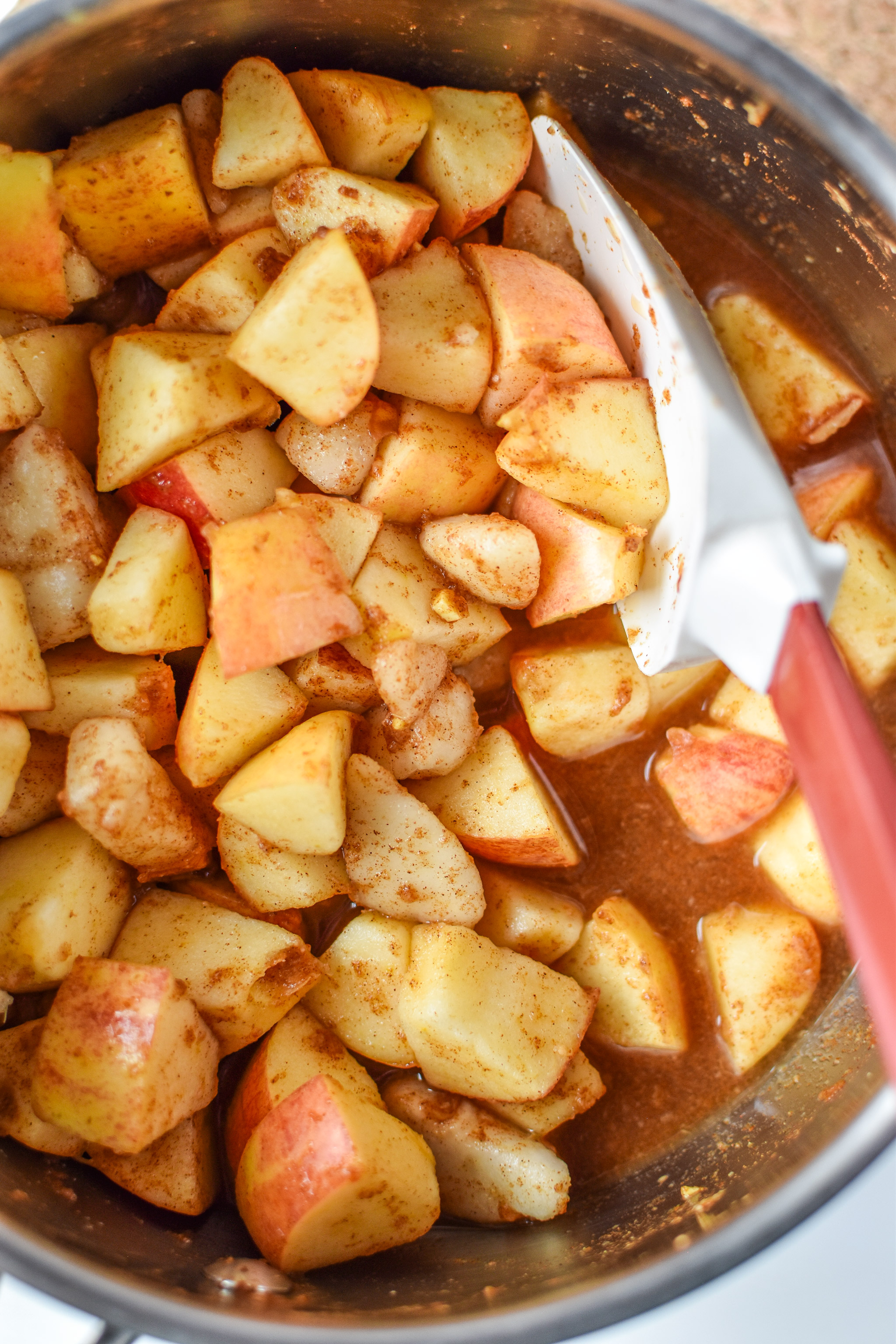 Mixed apples, pears and cinnamon in water for the Ginger Pear Cinnamon Applesauce