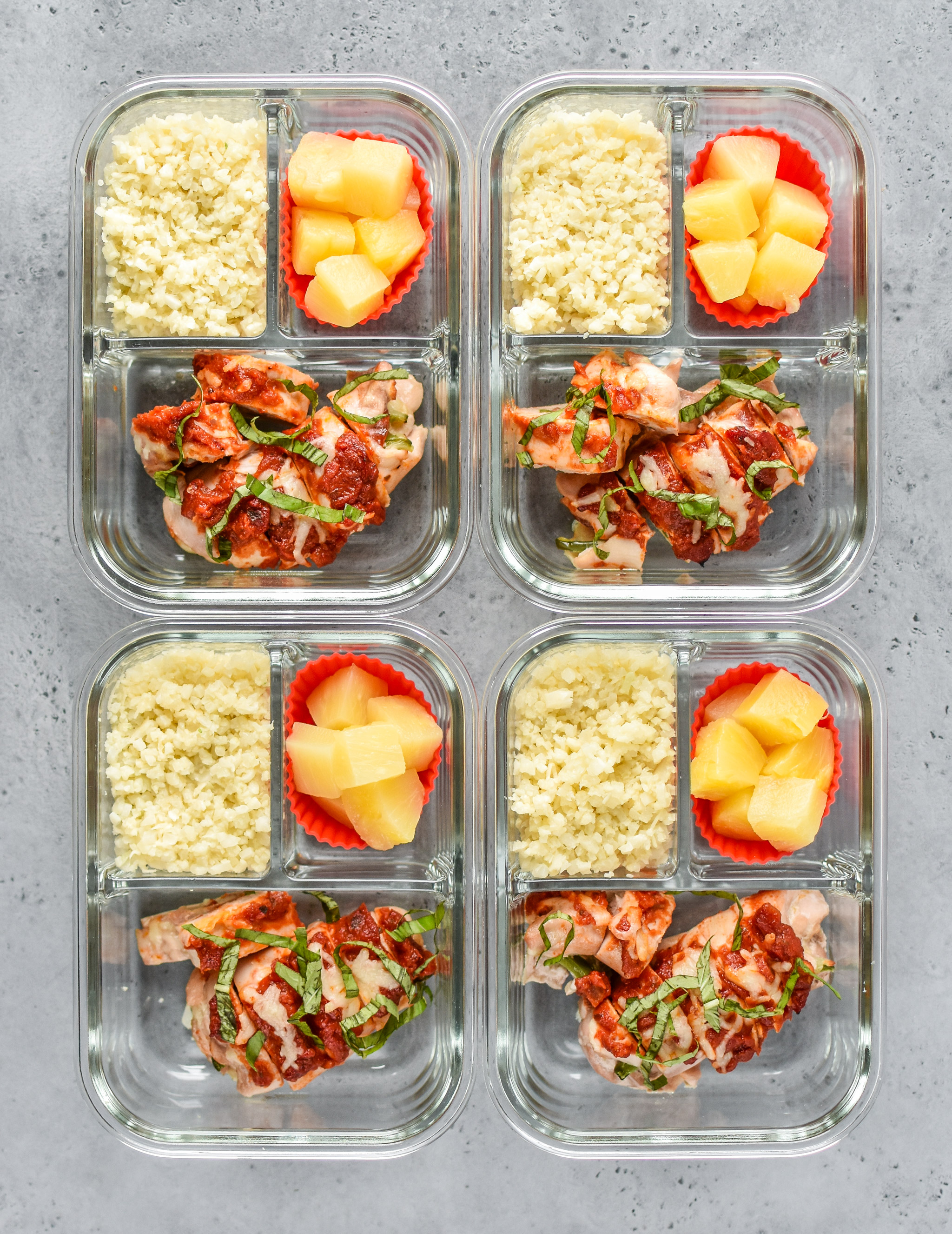 Pizza Chicken Roll Ups Meal Prep portioned out into containers and viewed from above