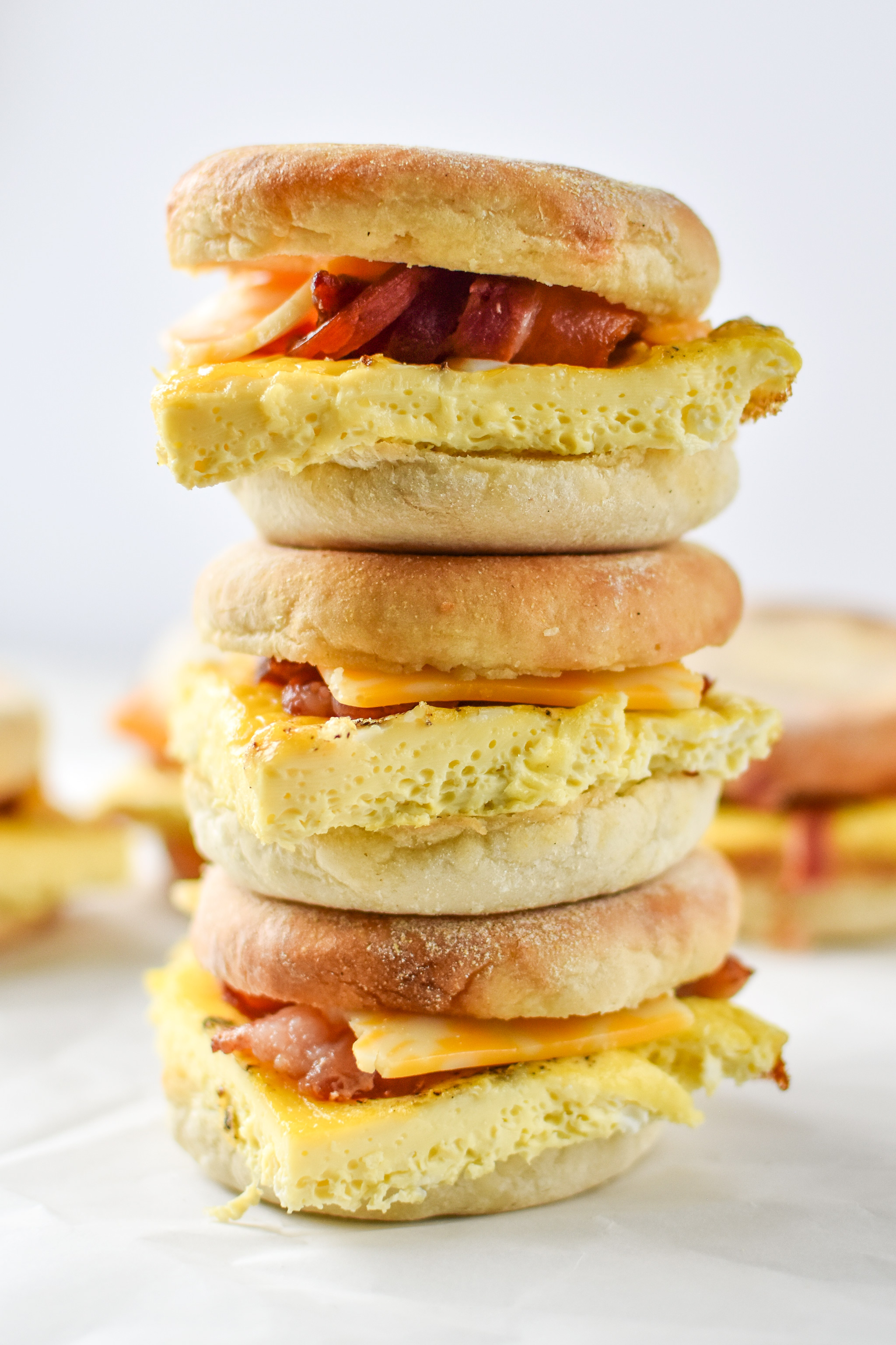 Delicious make-ahead bacon breakfast sandwiches stacked on top of each other