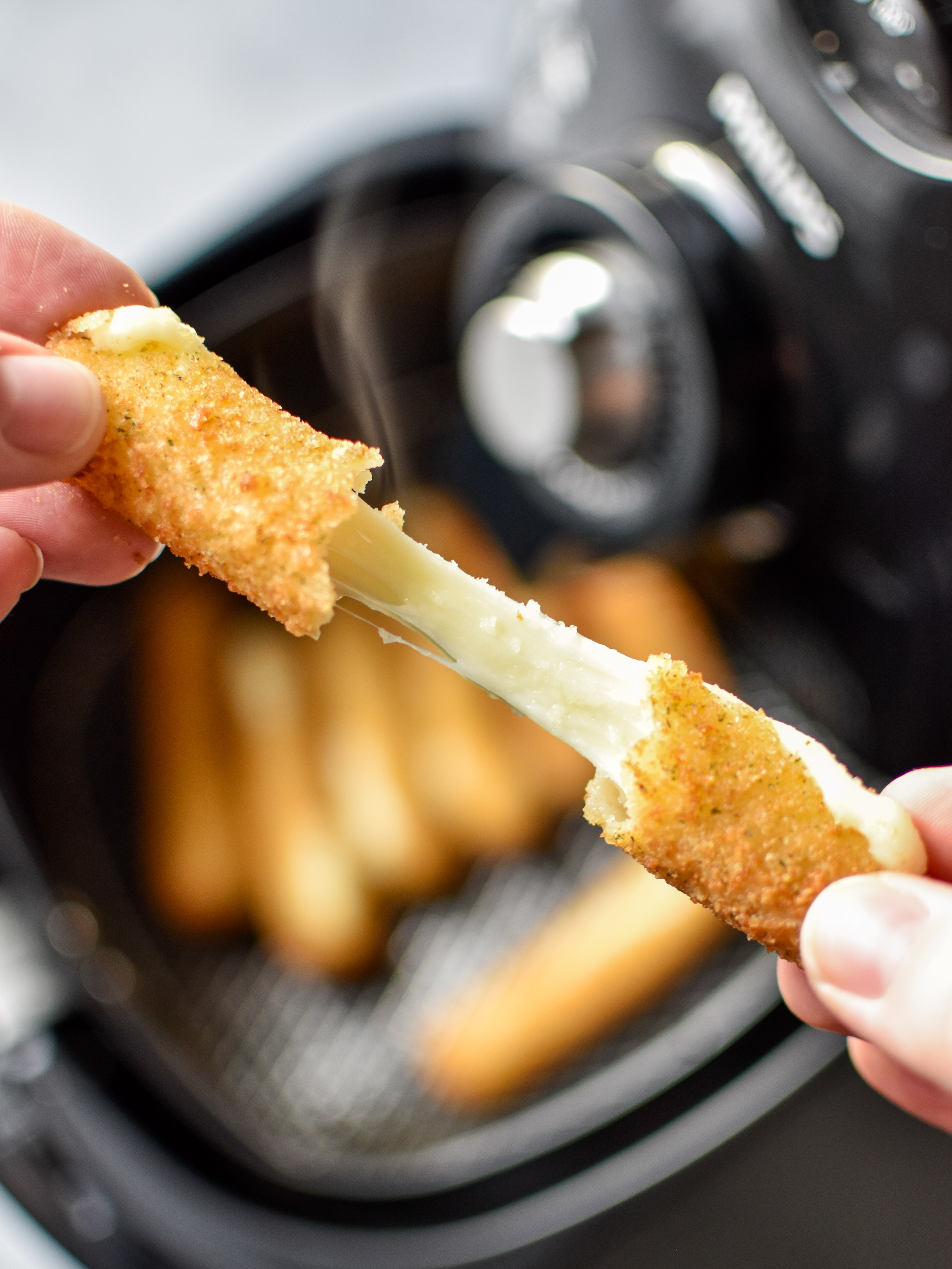 Cheesy mozzarella stick made in the air fryer!