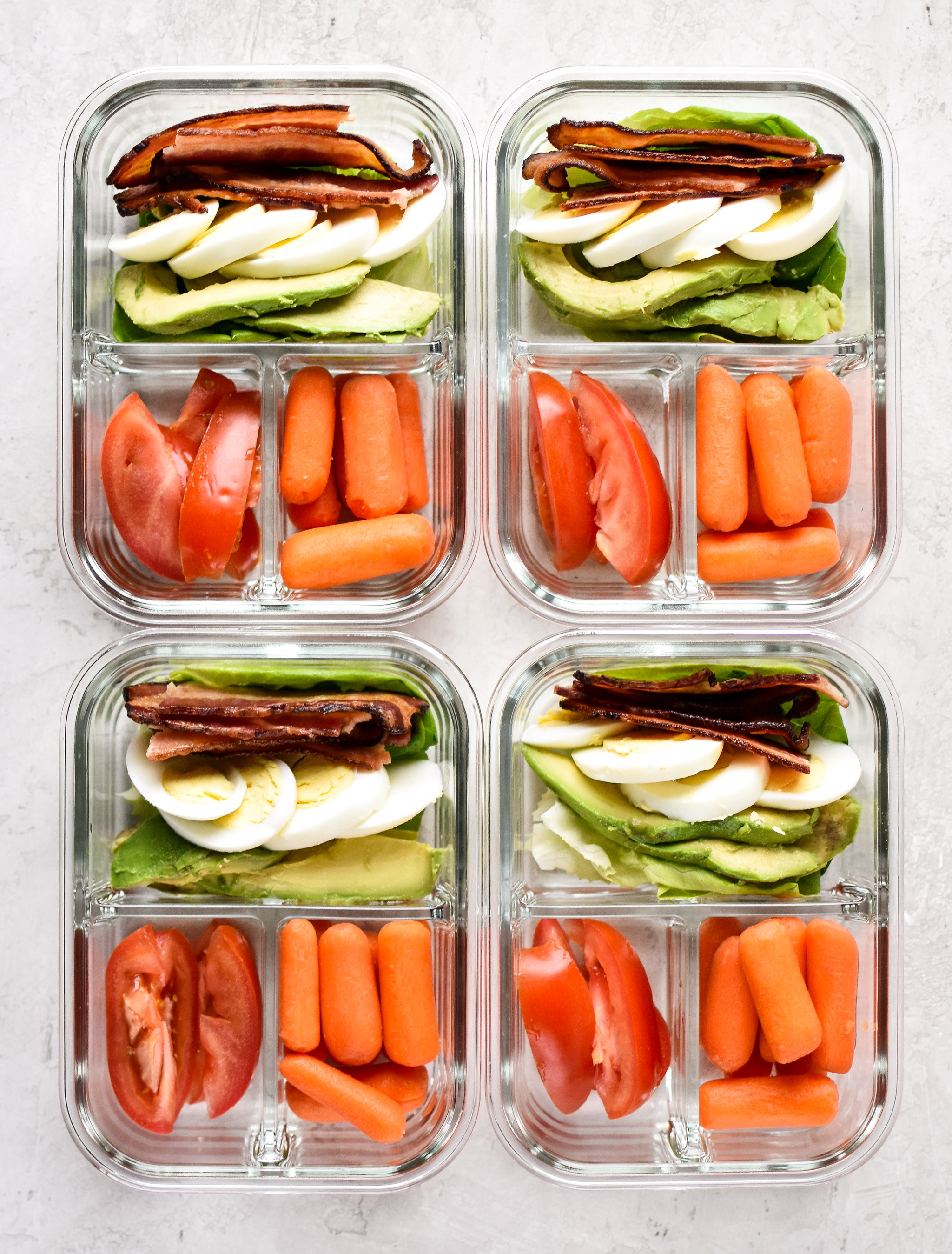 BLTA Lettuce Wraps Meal Prep pictured in 4 meal prep containers from above with baby carrots.