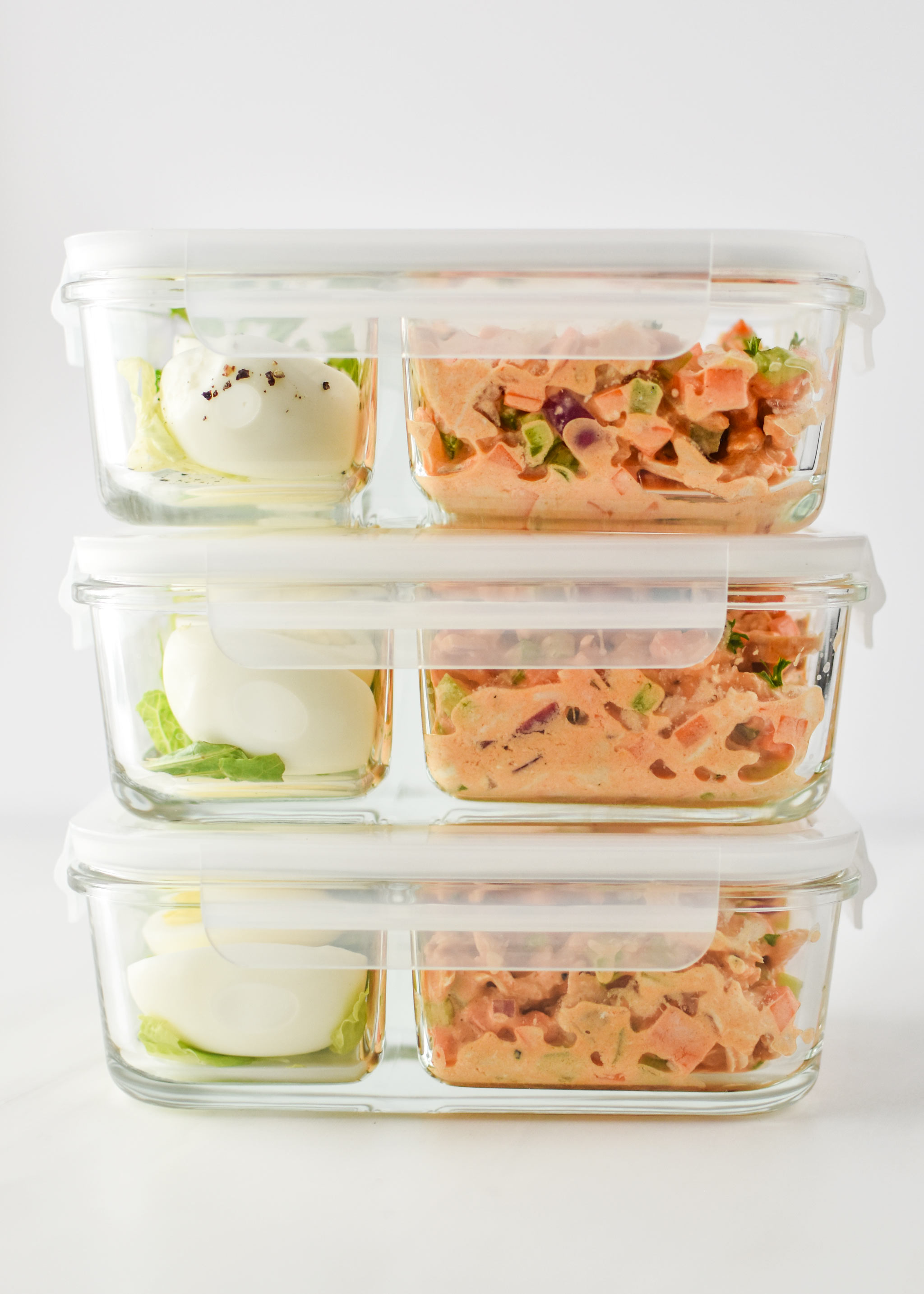 Easy buffalo chicken salad meal prepped into 3 containers