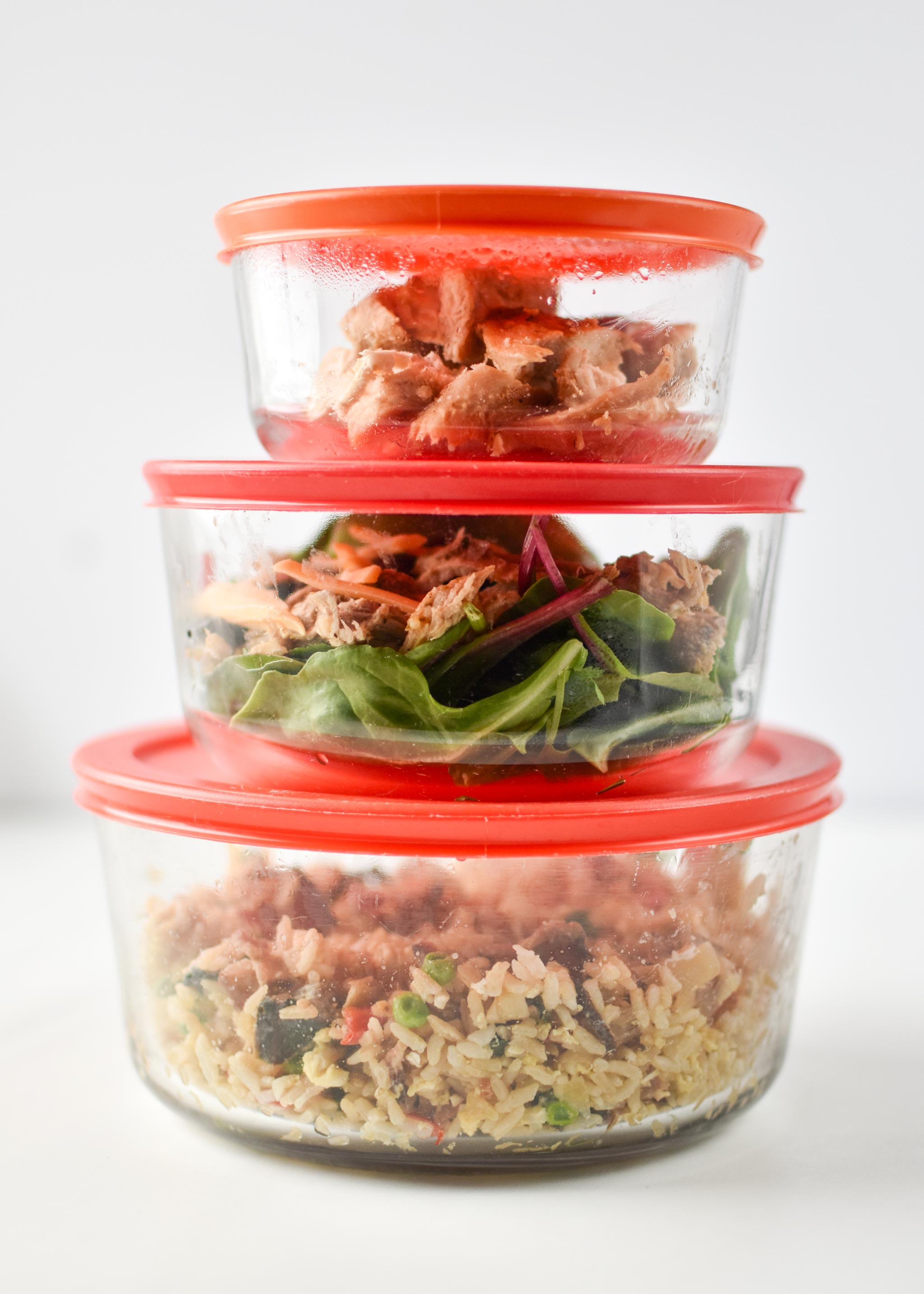 Three glass Pyrex containers with leftovers from my fridge - 7 cup, 4 cup, and 2 cup size.