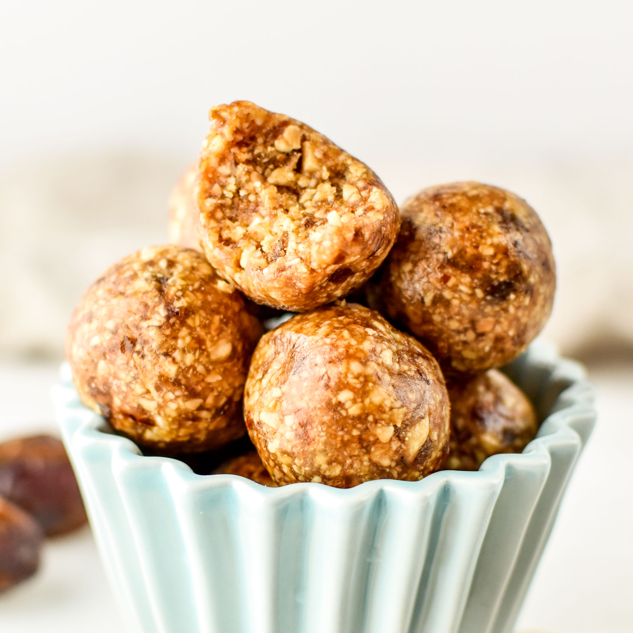 Peanut butter cookie balls on display - top one with a bite taken out.