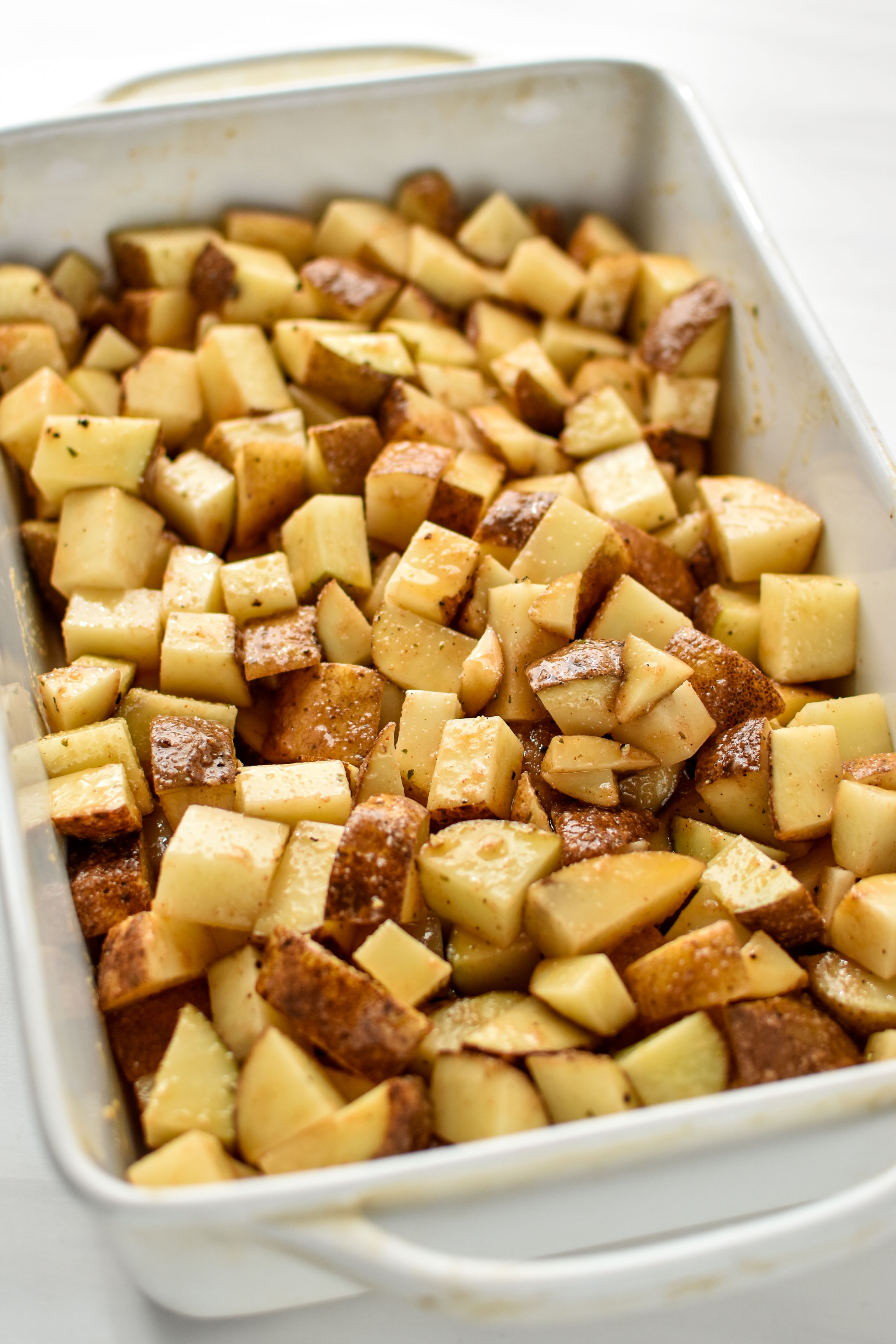 potatoes in the casserole dish for the chicken bacon ranch potato bake
