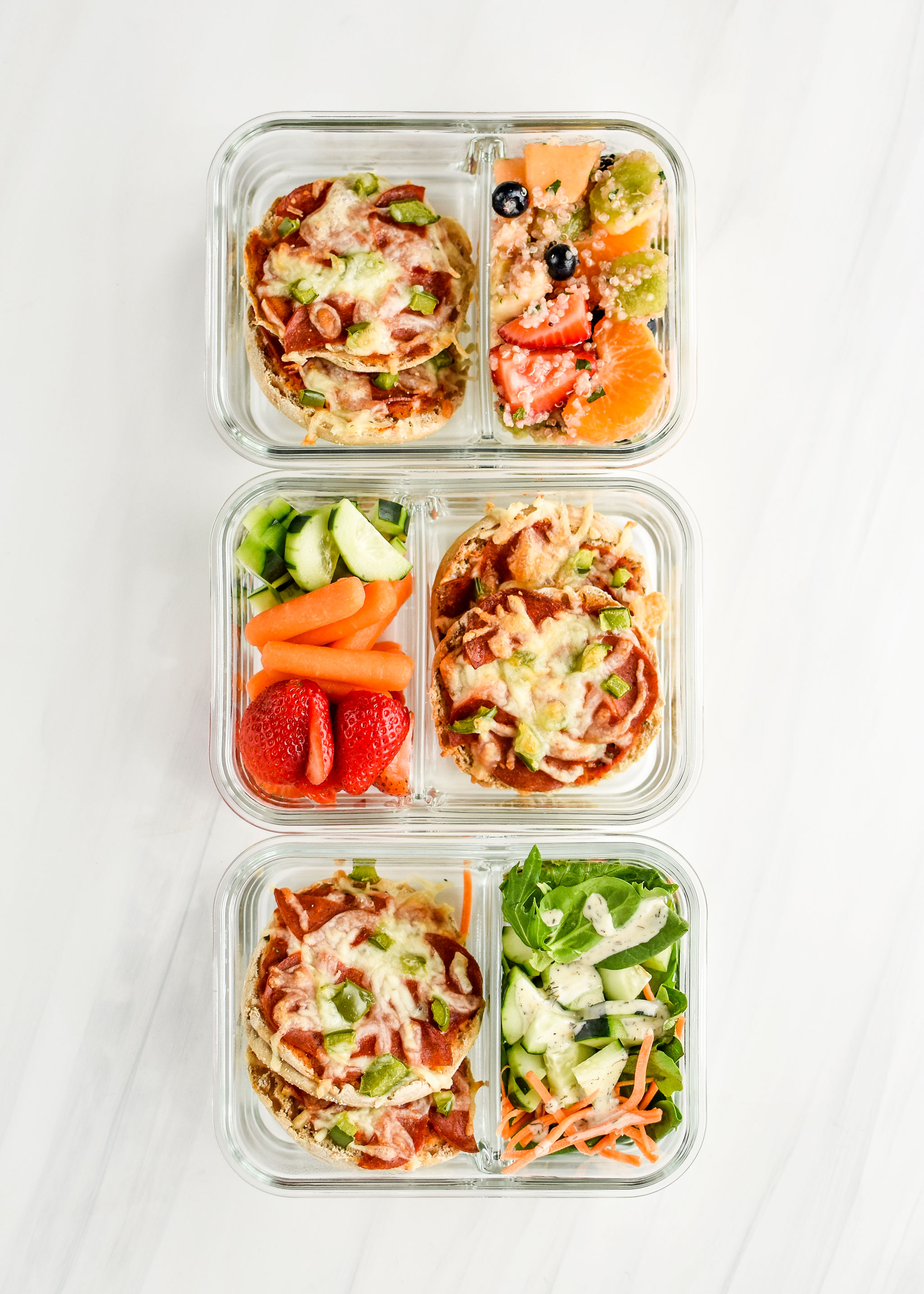 English muffin mini pizzas pictured in meal prep containers with fresh produce or salads.