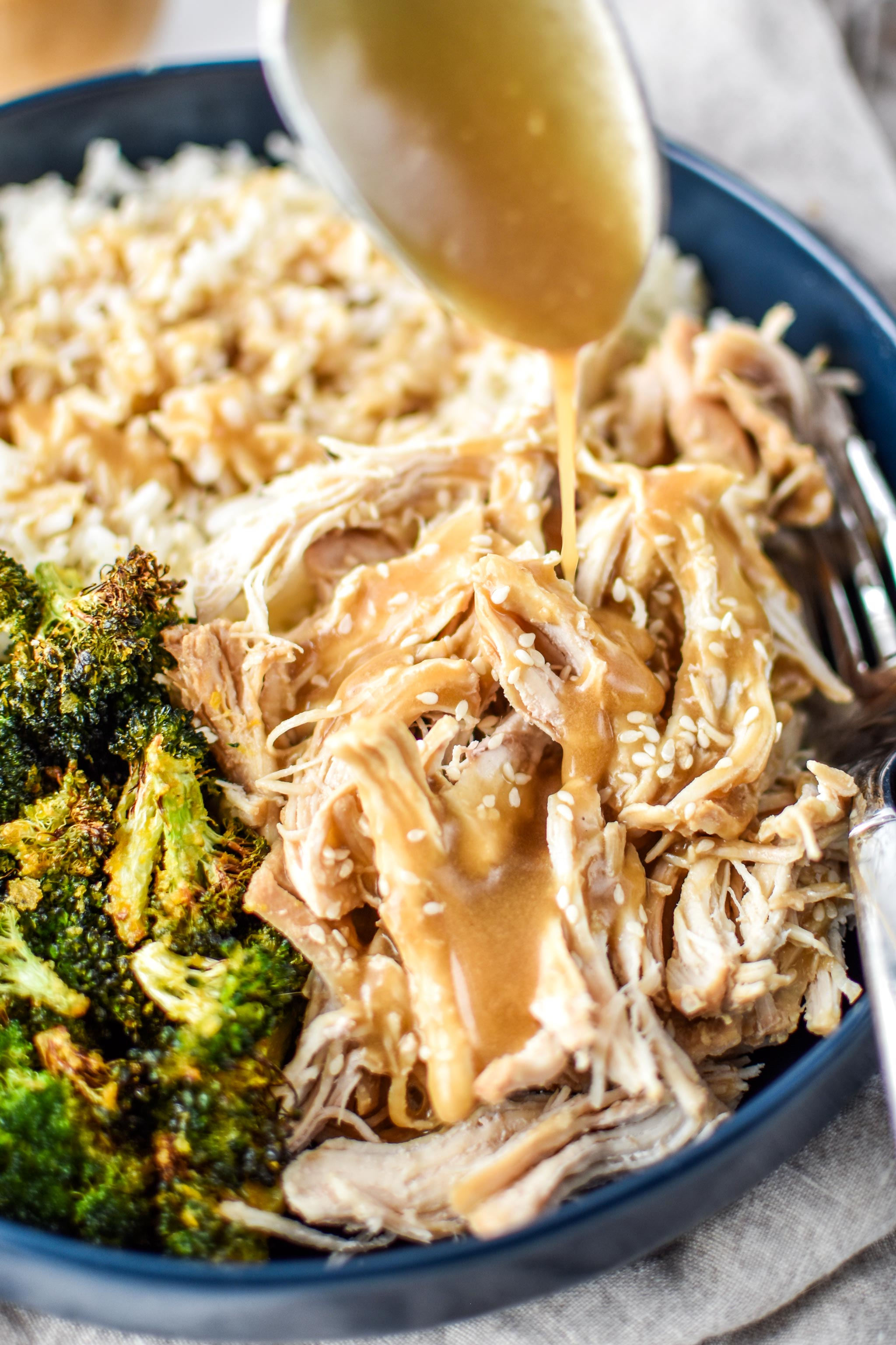 Eating sesame shredded chicken with rice and broccoli