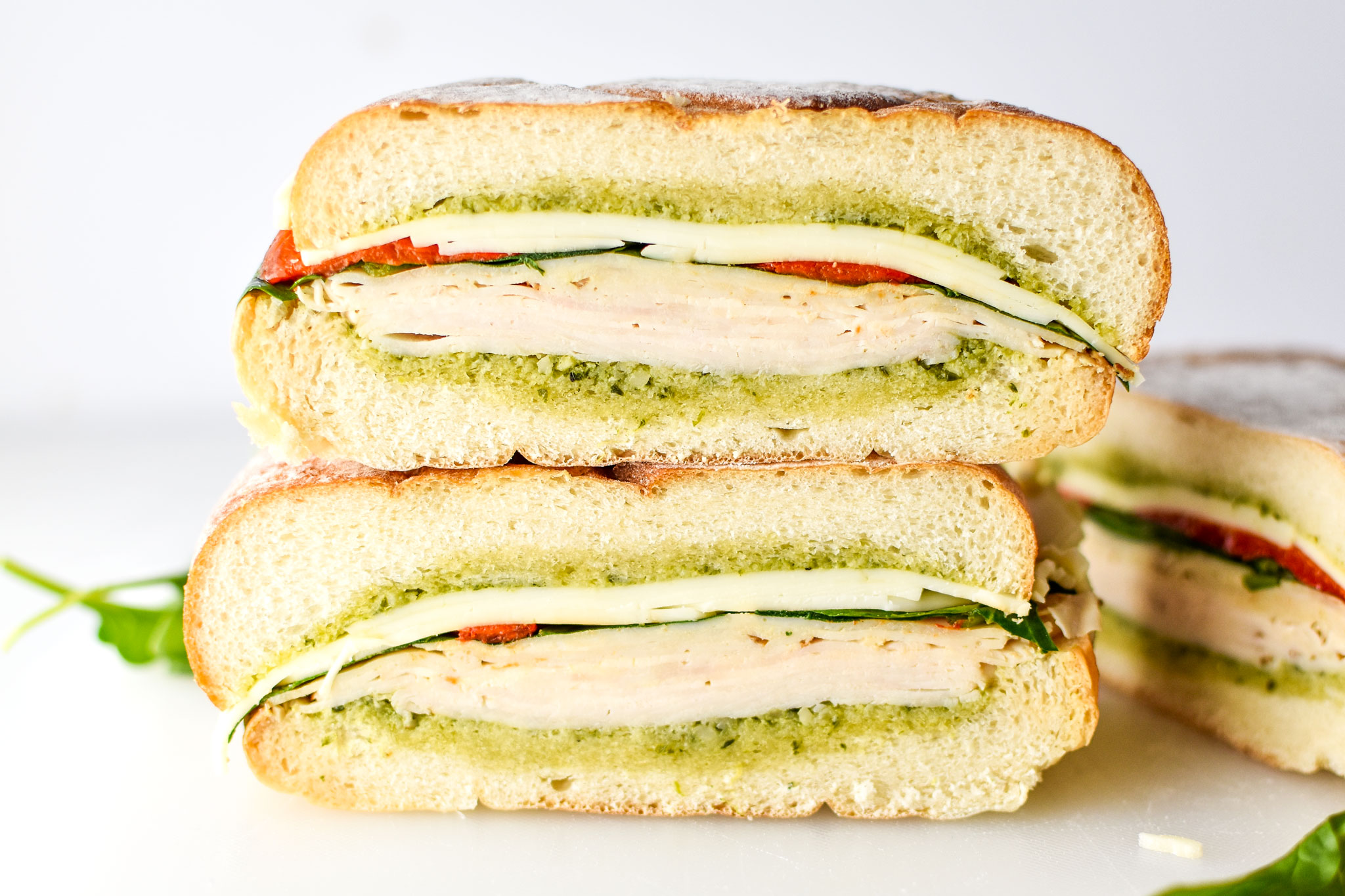 inside of the pesto chicken overnight pressed sandwiches