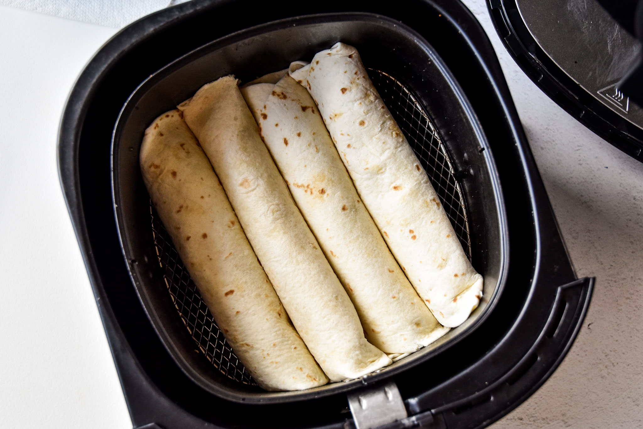 air fryer chicken taquitos ready to be cooked in the air fryer