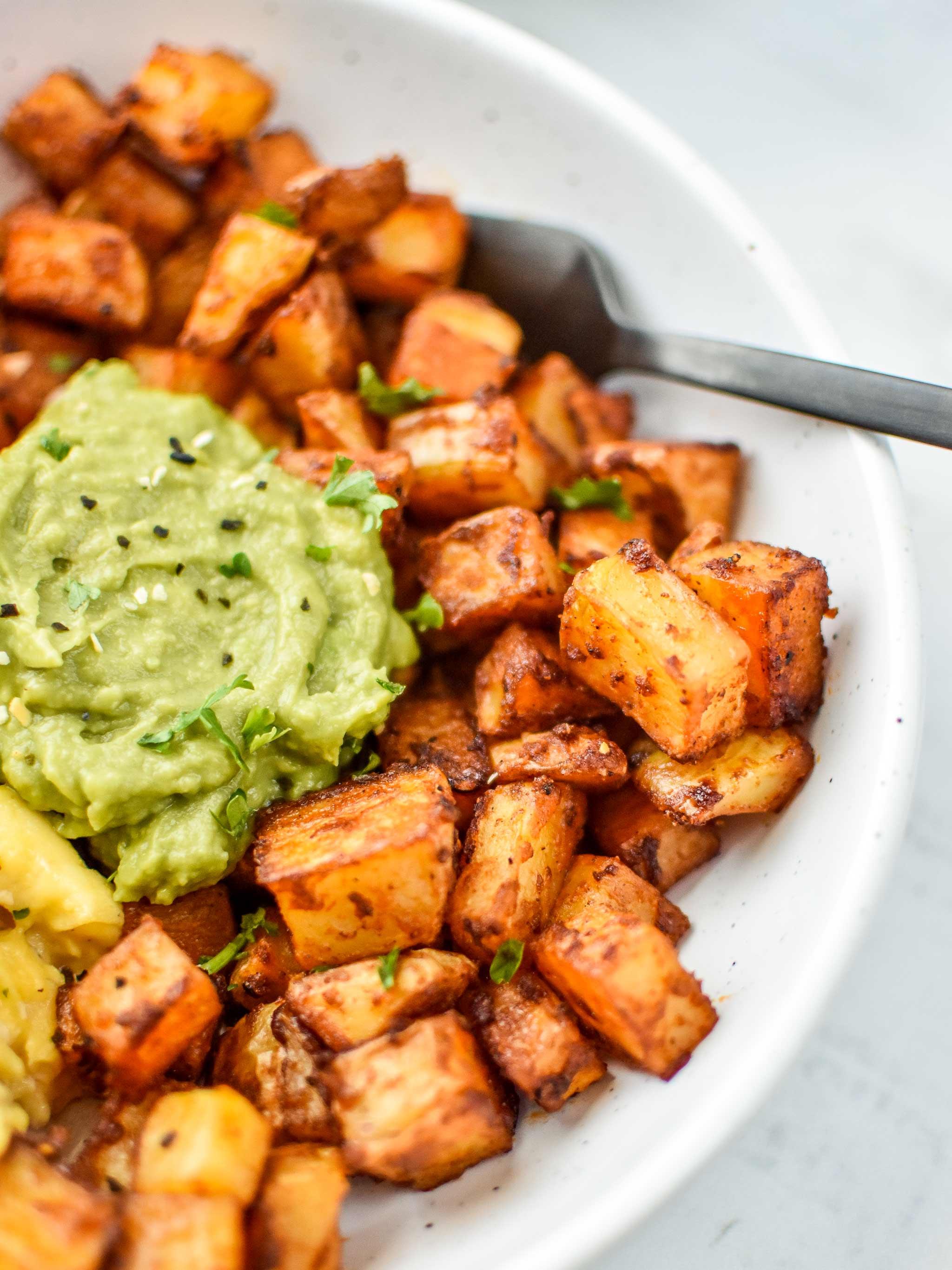 Basic oven breakfast potatoes with mashed avocado