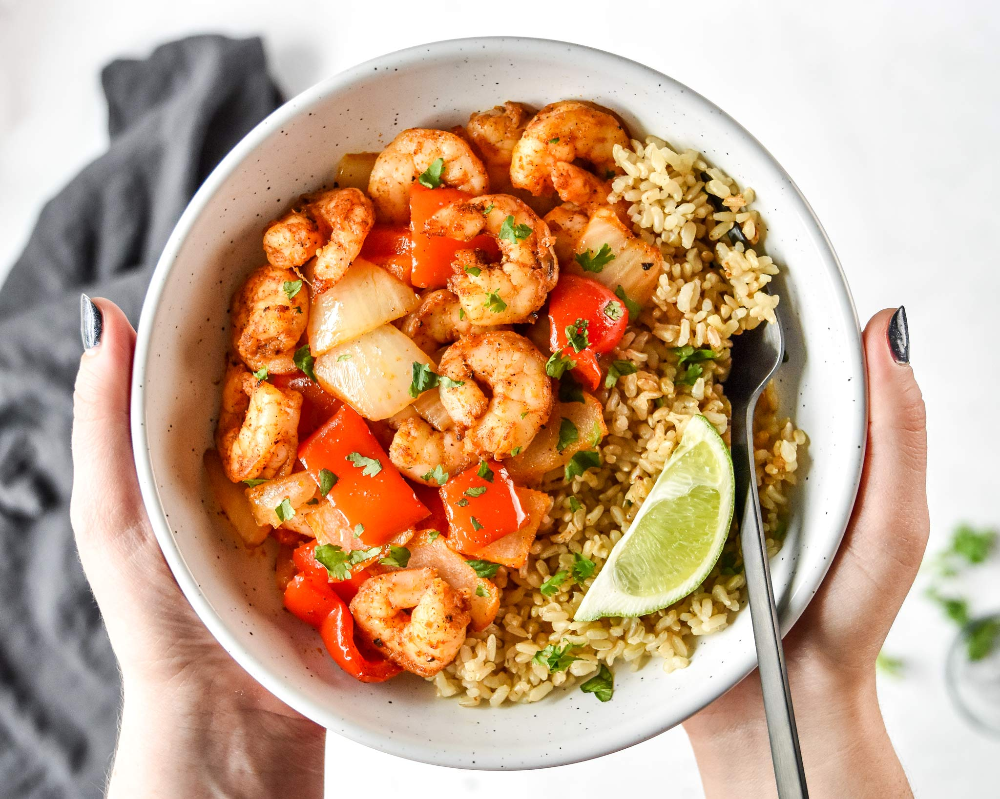 easy air fryer shrimp and vegetables served with rice and a lime wedge