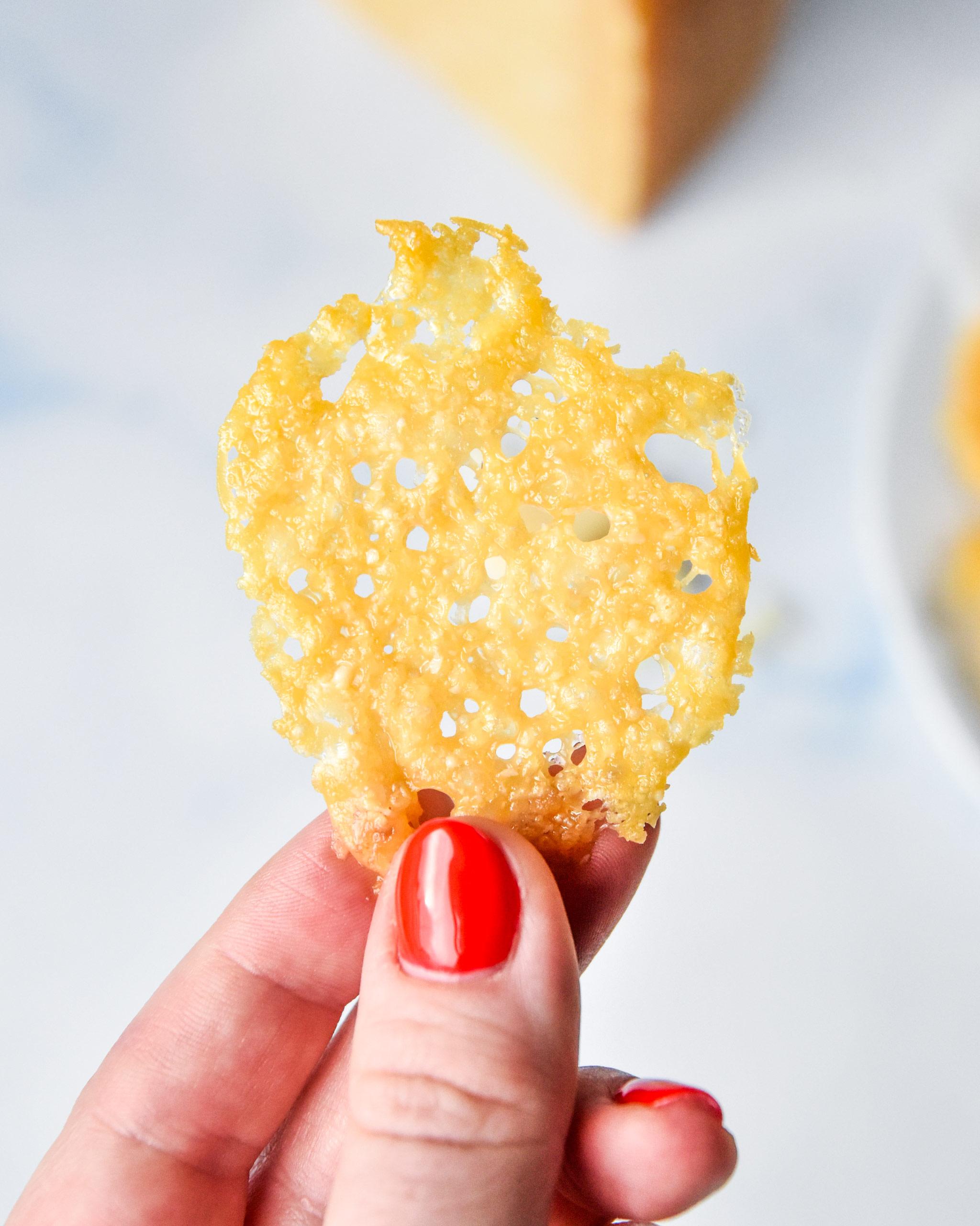 holding a baked parmesan crisp