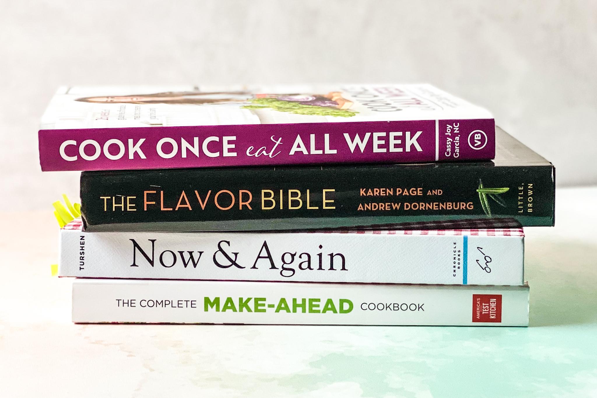 stack of meal prep cookbooks